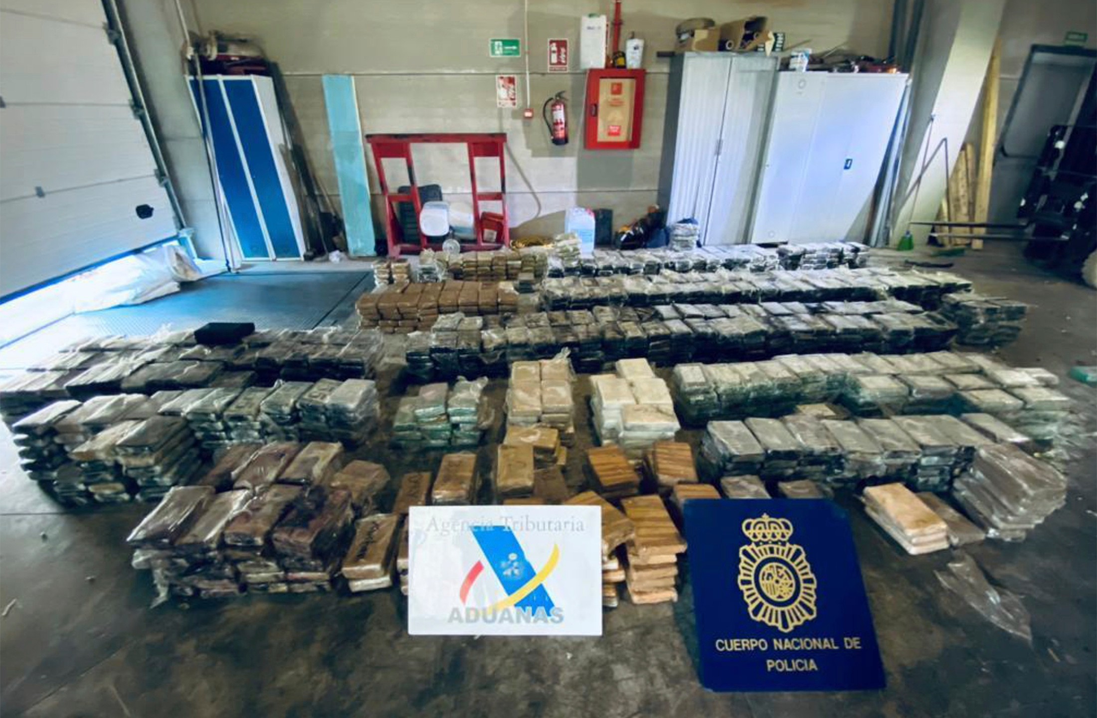 """This May 2021 image from an affidavit for a search warrant, provided by the U.S. Department of Justice, shows cocaine that had been transported in hollowed-out pineapples from Costa Rica to Spain. Law enforcement agencies learned about the shipment as part of a global sting operation unveiled Tuesday, June 8, 2021, that intercepted text messages criminals thought were secure. Authorities they said dealt an """"unprecedented blow"""" to organized crime in countries around the world. (Department of Justice via AP)"""