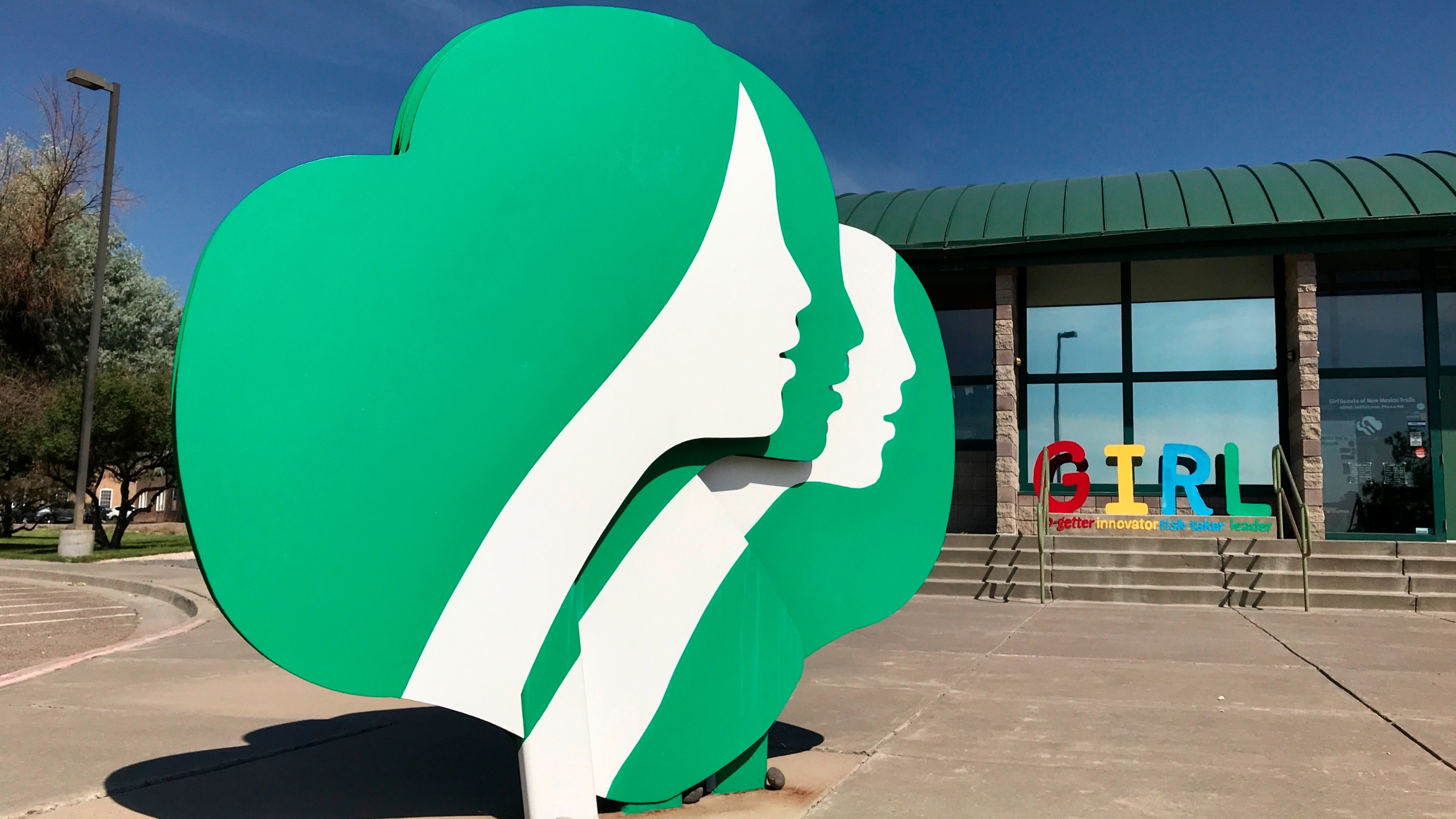 This June 7, 2021, image shows the headquarters of Girl Scouts of New Mexico Trails in Albuquerque, New Mexico. Rebecca Latham, CEO of Girl Scouts of New Mexico Trails, said her council had thousands of boxes left over at the end of the selling season in late spring, even though girls tried innovative selling methods like drive-thru booths and contact-free delivery. (AP Photo/Susan Montoya Bryan)
