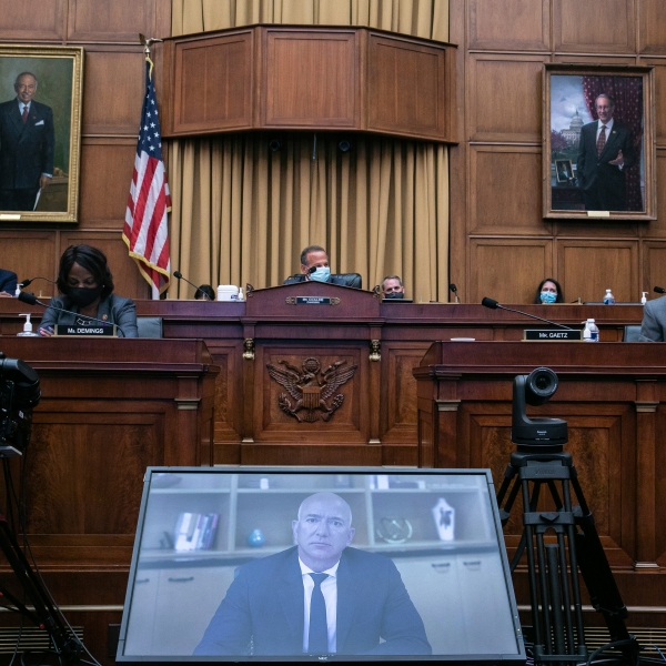 In this July 29, 2020, file photo Amazon CEO Jeff Bezos speaks via video conference during a House Judiciary subcommittee hearing on antitrust on Capitol Hill in Washington. A group of House lawmakers put forward a sweeping legislative package Friday that could curb the market power of Big Tech companies and force Facebook, Google, Amazon or Apple to sever their dominant platforms from their other lines of business. (Graeme Jennings/Pool via AP, File)