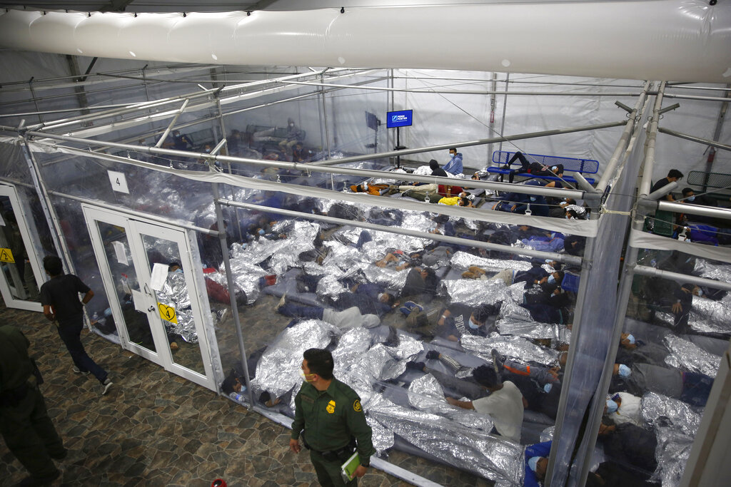 In this March 30, 2021, file photo, minors are shown inside a pod at the Donna Department of Homeland Security holding facility, the main detention center for unaccompanied children in the Rio Grande Valley run by U.S. Customs and Border Protection (CBP), in Donna, Texas. (AP Photo/Dario Lopez-Mills, Pool,File)