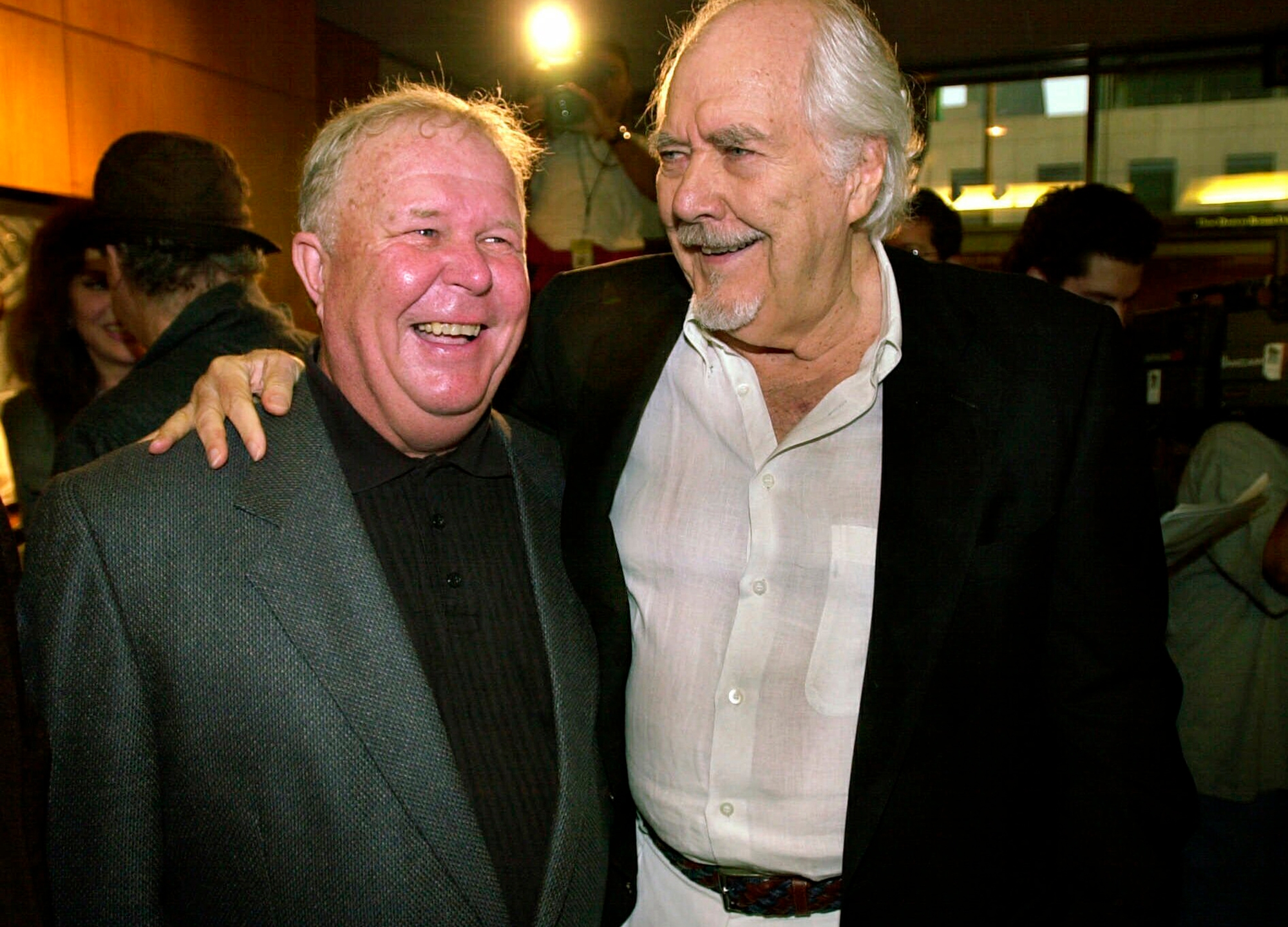 """In this Thursday, June 22, 2000, file photo, director-producer Robert Altman, right, laughs with actor Ned Beatty prior to the 25th anniversary screening of """"Nashville,"""" at the Academy of Motion Picture Arts and Sciences in Beverly Hills, Calif. Beatty portrayed Delbert Reese in Altman's film. Beatty, the indelible character actor whose first film role, as a genial vacationer brutally raped by a backwoodsman in 1972′s """"Deliverance,"""" launched him on a long, prolific and accomplished career, died Sunday, June 13, 2021. He was 83. (AP Photo/Michael Caulfield, File)"""