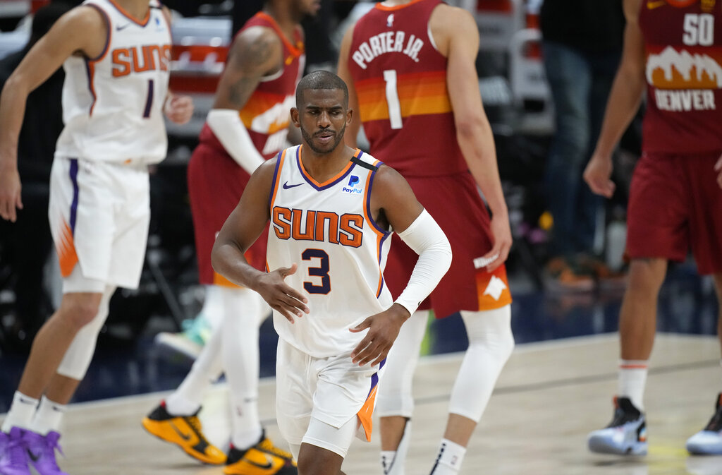 Phoenix Suns guard Chris Paul, front, reacts after hitting a basket late in the second half of Game 4 of an NBA second-round playoff series against the Denver Nuggets, Sunday, June 13, 2021, in Denver. (AP Photo/David Zalubowski)