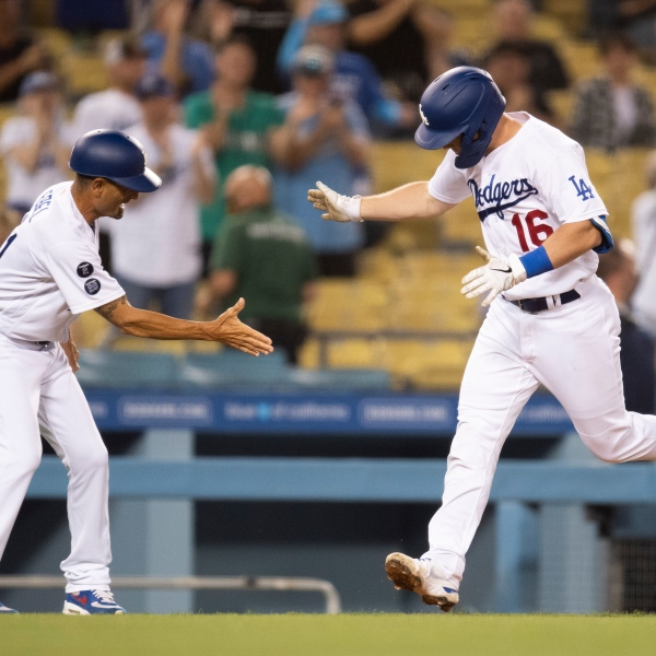 Los Angeles Dodgers' Will Smith, right, celebrates his two-run home run with third base coach Dino Ebel during the fourth inning of a baseball game against the Philadelphia Phillies in Los Angeles on June 14, 2021. (AP Photo/Kyusung Gong)