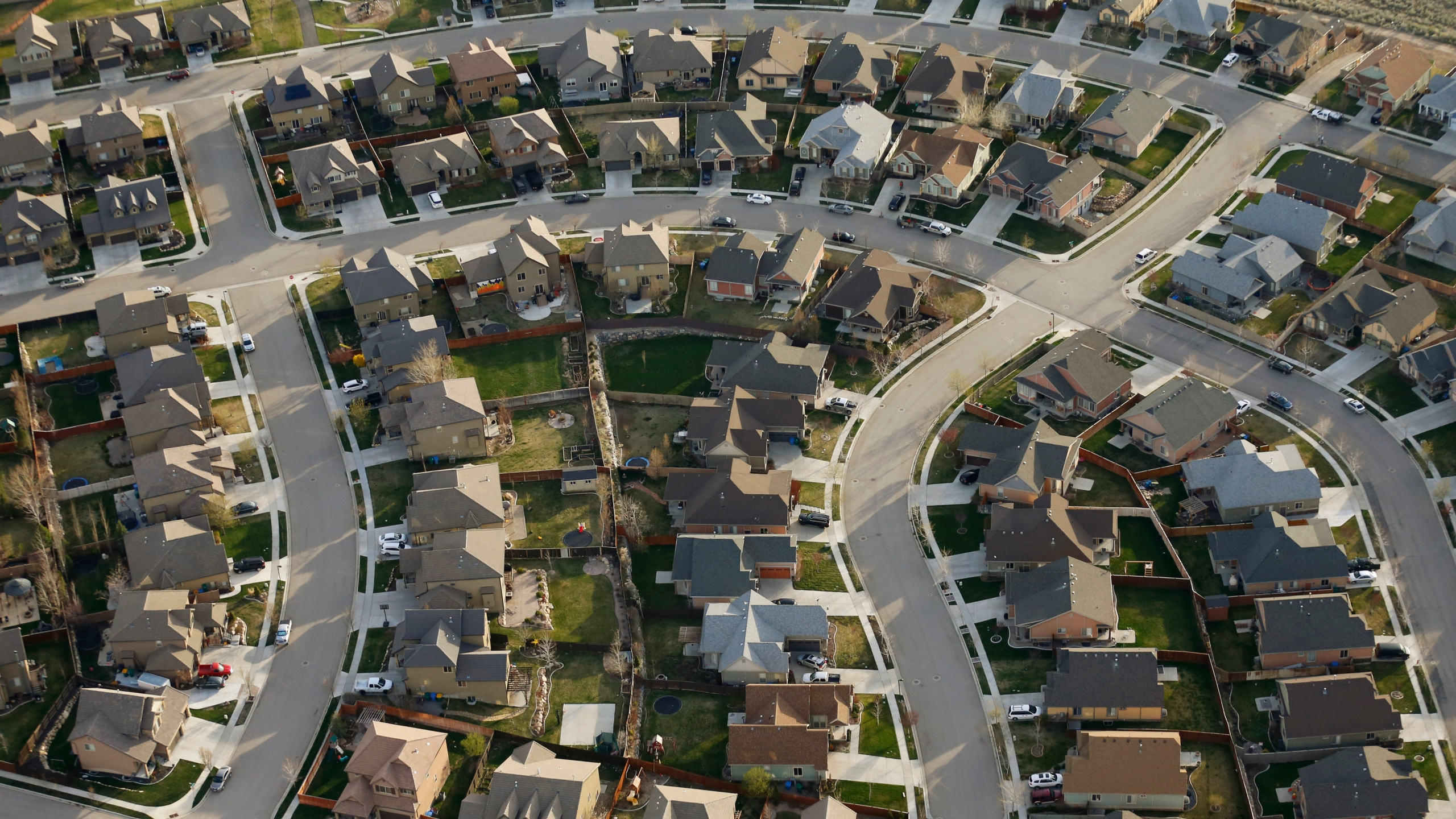 This April 13, 2019, file photo, shows homes in suburban Salt Lake City. (AP Photo/Rick Bowmer, File)
