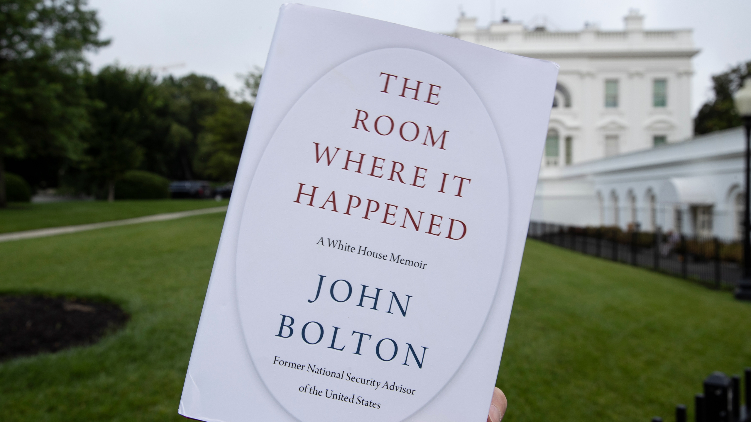 """This June 18, 2020, file photo shows a copy of """"The Room Where It Happened"""" by former national security adviser John Bolton. (Alex Brandon/Associated Press)"""