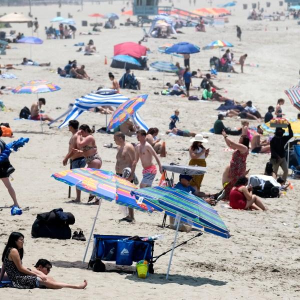 Beachgoers try to beat the heat at Santa Monica Beach on Wednesday, June 16, 2021, in Santa Monica, Calif. (AP Photo/Ringo H.W. Chiu)
