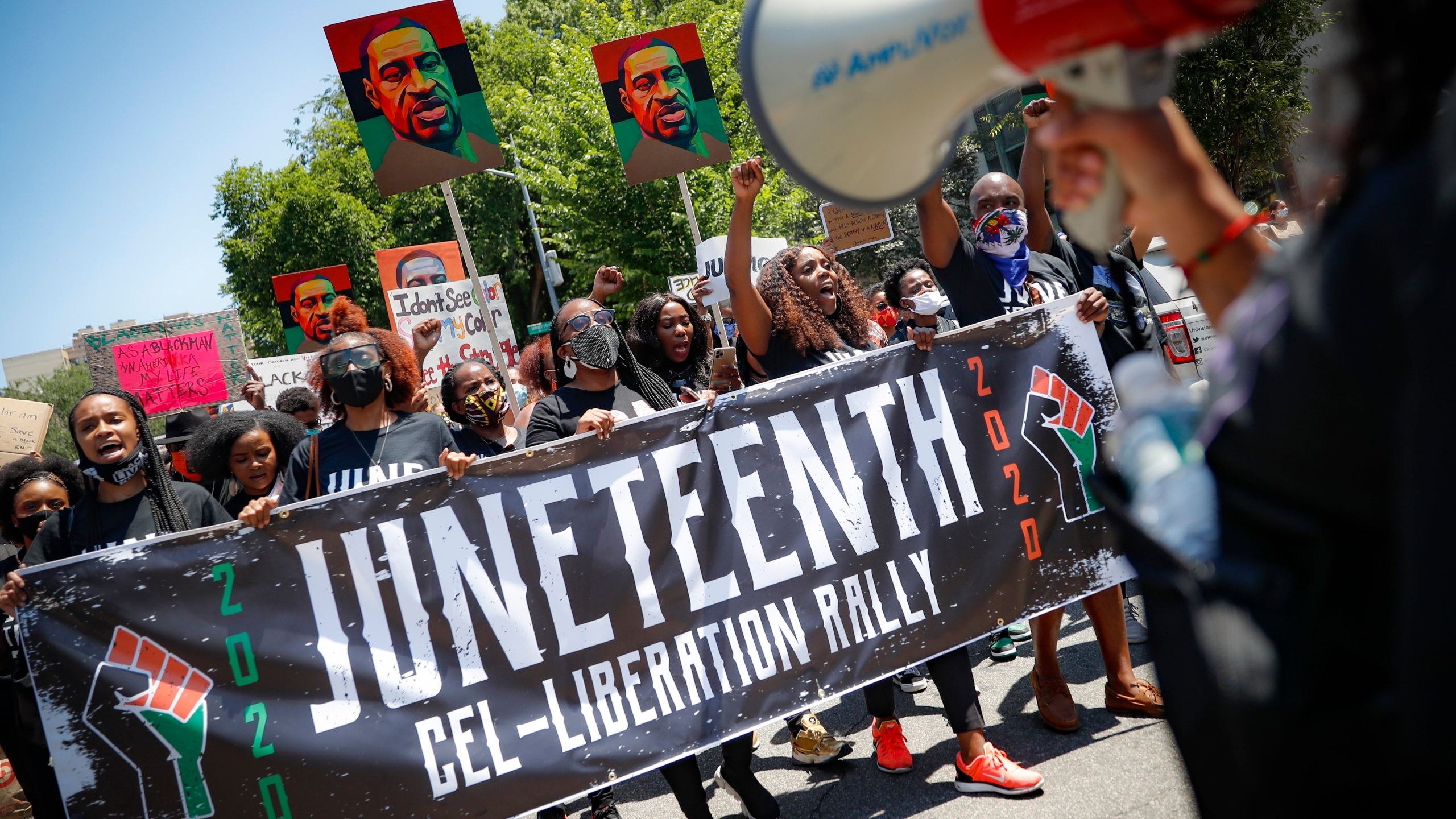 In this June 19, 2020, file photo, protesters chant as they march after a Juneteenth rally at the Brooklyn Museum. (John Minchillo/Associated Press)