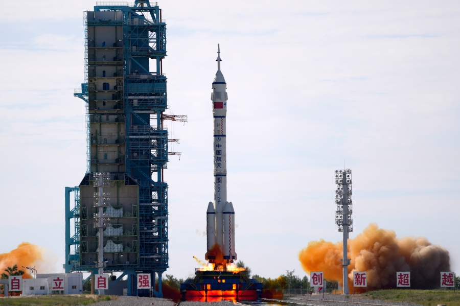 A Long March-2F Y12 rocket carrying a crew of Chinese astronauts in a Shenzhou-12 spaceship lifts off at the Jiuquan Satellite Launch Center in Jiuquan in northwestern China on June 17, 2021.  (AP Photo/Ng Han Guan)