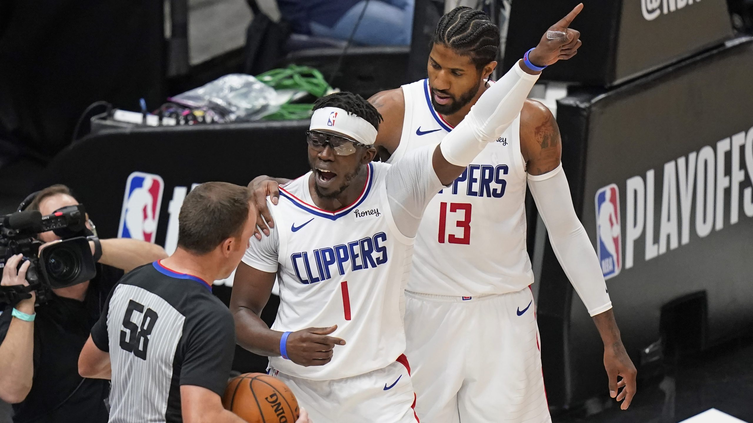 Los Angeles Clippers guard Reggie Jackson (1) argues with referee Josh Tiven (58) during the first half of Game 5 of the team's second-round NBA basketball playoff series against the Utah Jazz on June 16, 2021, in Salt Lake City. (Rick Bowmer / Associated Press)