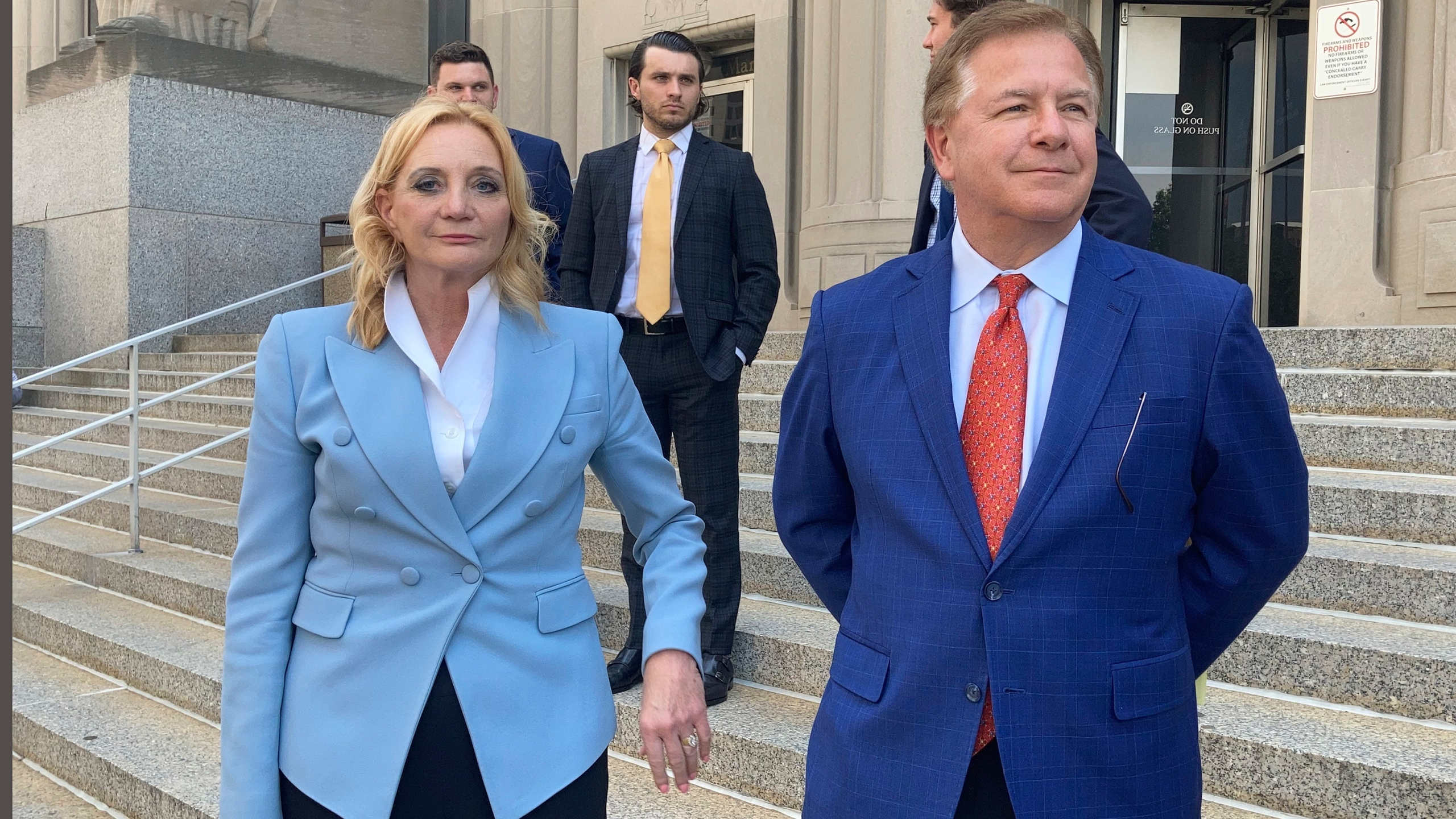 Patricia McCloskey, left, and her husband Mark McCloskey leave a court in St. Louis on June 17, 2021. (Jim Salter/Associated Press)
