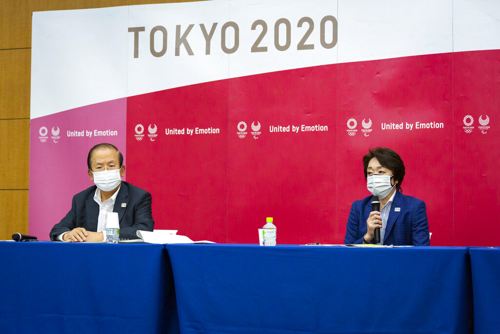 Tokyo 2020 CEO Toshiro Muto, left, and President Seiko Hashimoto attend the news conference after receiving a report from a group of infectious disease experts on Friday, June 18, 2021, in Tokyo. (Yuichi Yamazaki/Pool Photo via AP)