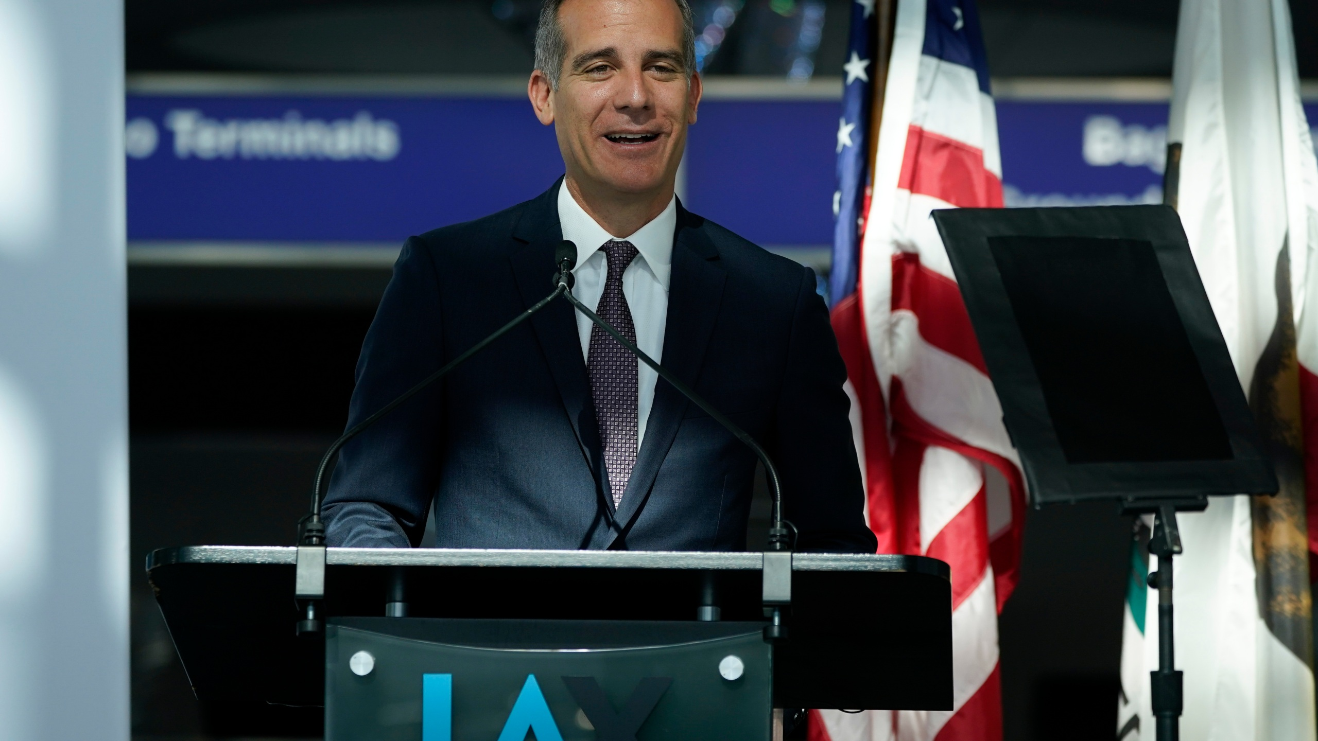 In this May 24, 2021 file photo Los Angeles Mayor Eric Garcetti speaks a press conference at Los Angeles International Airport, in Los Angeles. A group of 11 U.S. mayors have pledged to pay reparations for slavery to a small group of Black residents in their cities. The mayors have committed to form commissions to advise them on how to develop the programs. (AP Photo/Ashley Landis, File)