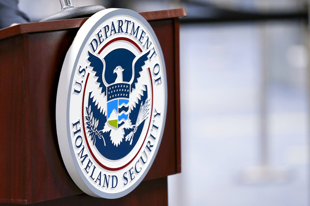 In this Nov. 20, 2020, file photo of a U.S. Department of Homeland Security plaque displayed on a podium in Miami. (AP Photo/Lynne Sladky, File)