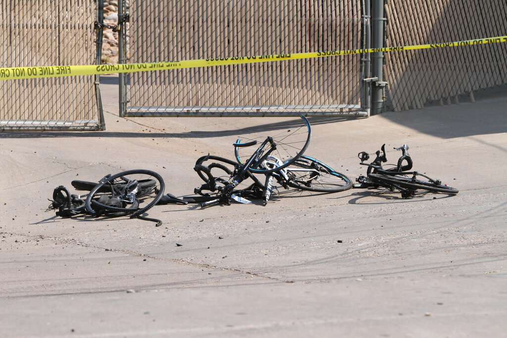 This Saturday, June 19, 2021, photo courtesy of The White Mountain Independent shows the scene of an accident with broken bicycles in Show Low, Ariz. (Jim Headley/The White Mountain Independent via AP)