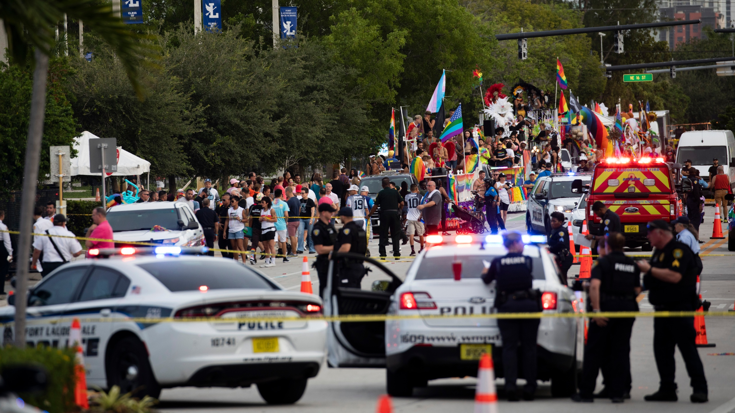 Police and firefighters respond after a truck drove into a crowd of people injuring them during The Stonewall Pride Parade and Street Festival in Wilton Manors, Fla., on Saturday, June 19, 2021. WPLG-TV reports that the driver of the truck was taken into custody. (Chris Day/South Florida Sun-Sentinel via AP)