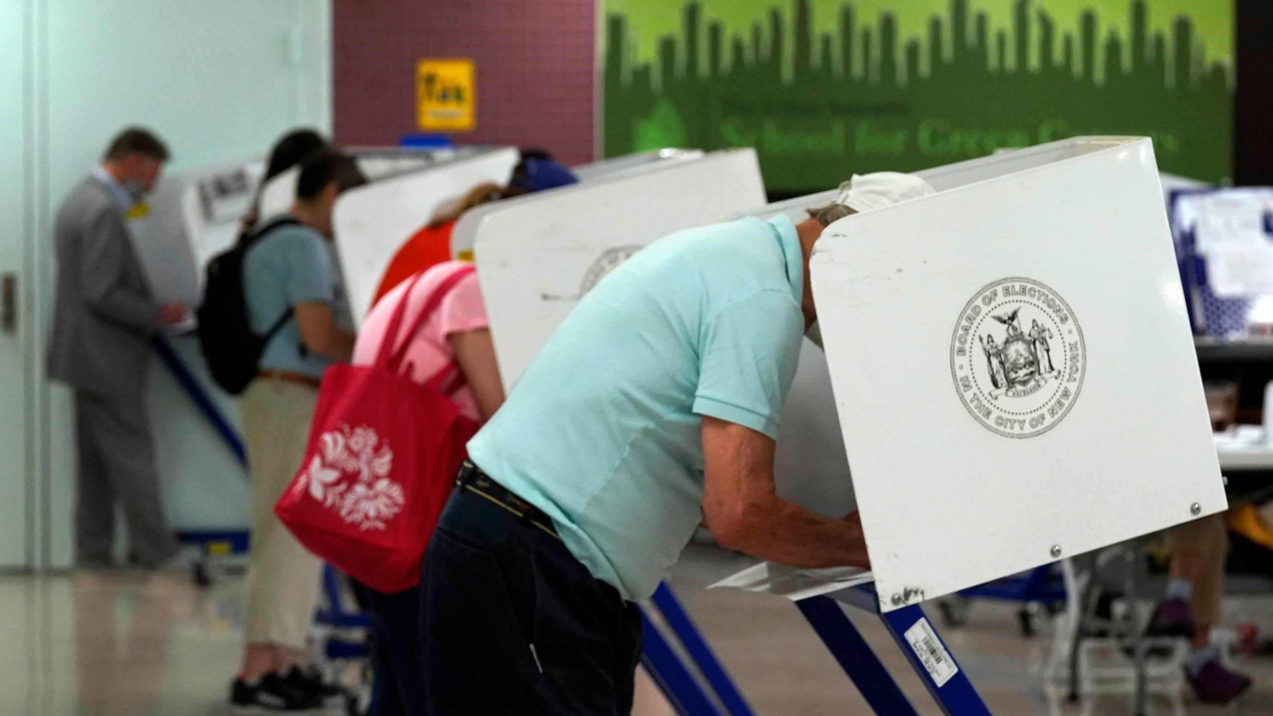 Voters mark their ballots at Frank McCourt High School, in New York, on June 22, 2021. (Richard Drew/Associated Press)