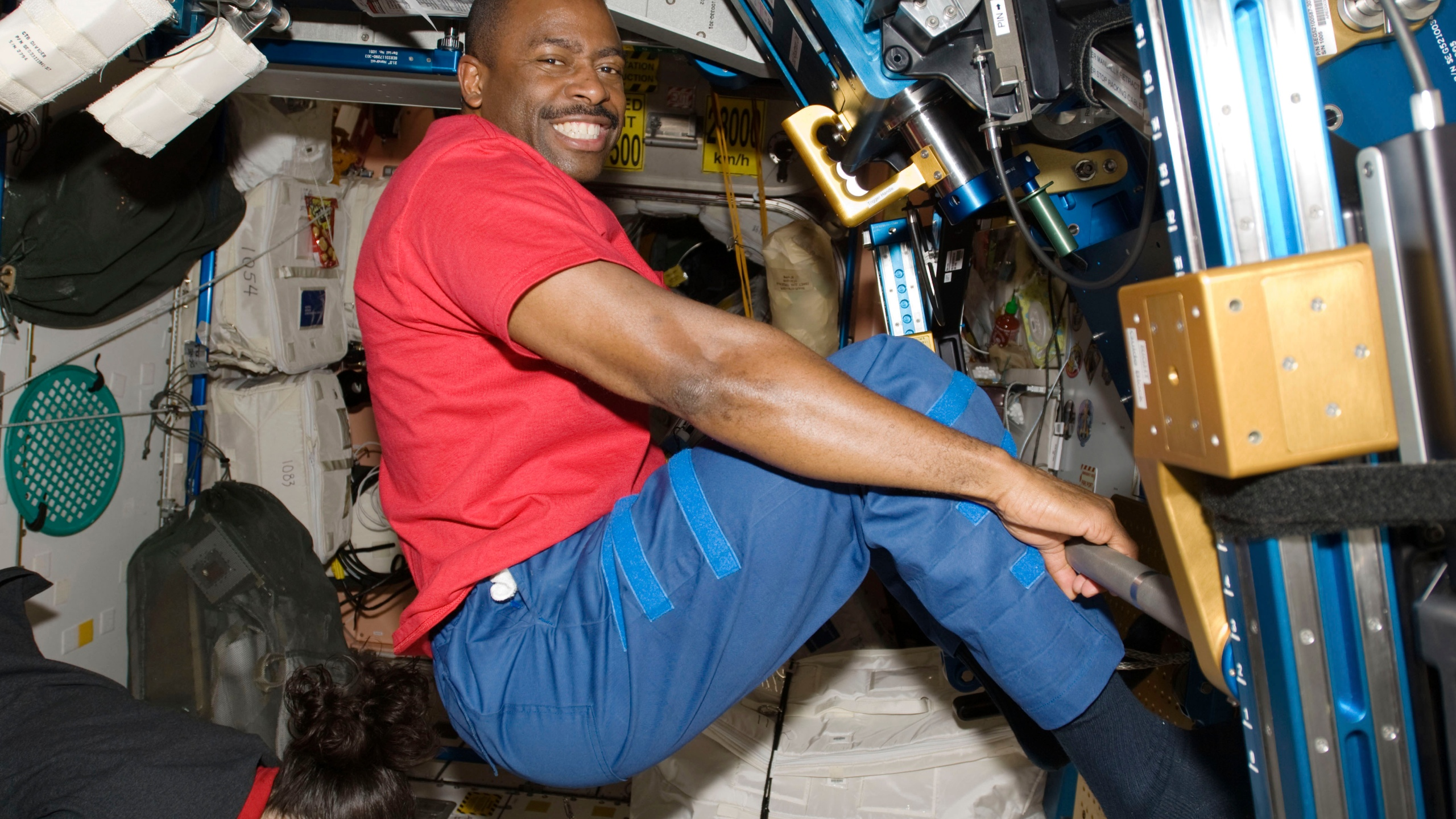 In this Nov. 22, 2009 photo made available by NASA, astronaut Leland Melvin, STS-129 mission specialist, exercises in the Unity module of the International Space Station while the space shuttle Atlantis is docked with the station. Space station astronauts exercise two hours every day to counter the muscle- and bone-withering effects of weightlessness, quickly leaving their workout clothes sweaty, smelly and stiff. Their T-shirts, shorts and socks end up so foul that they run through a pair every week, according to Melvin, a former NASA astronaut and NFL player. (NASA via AP)