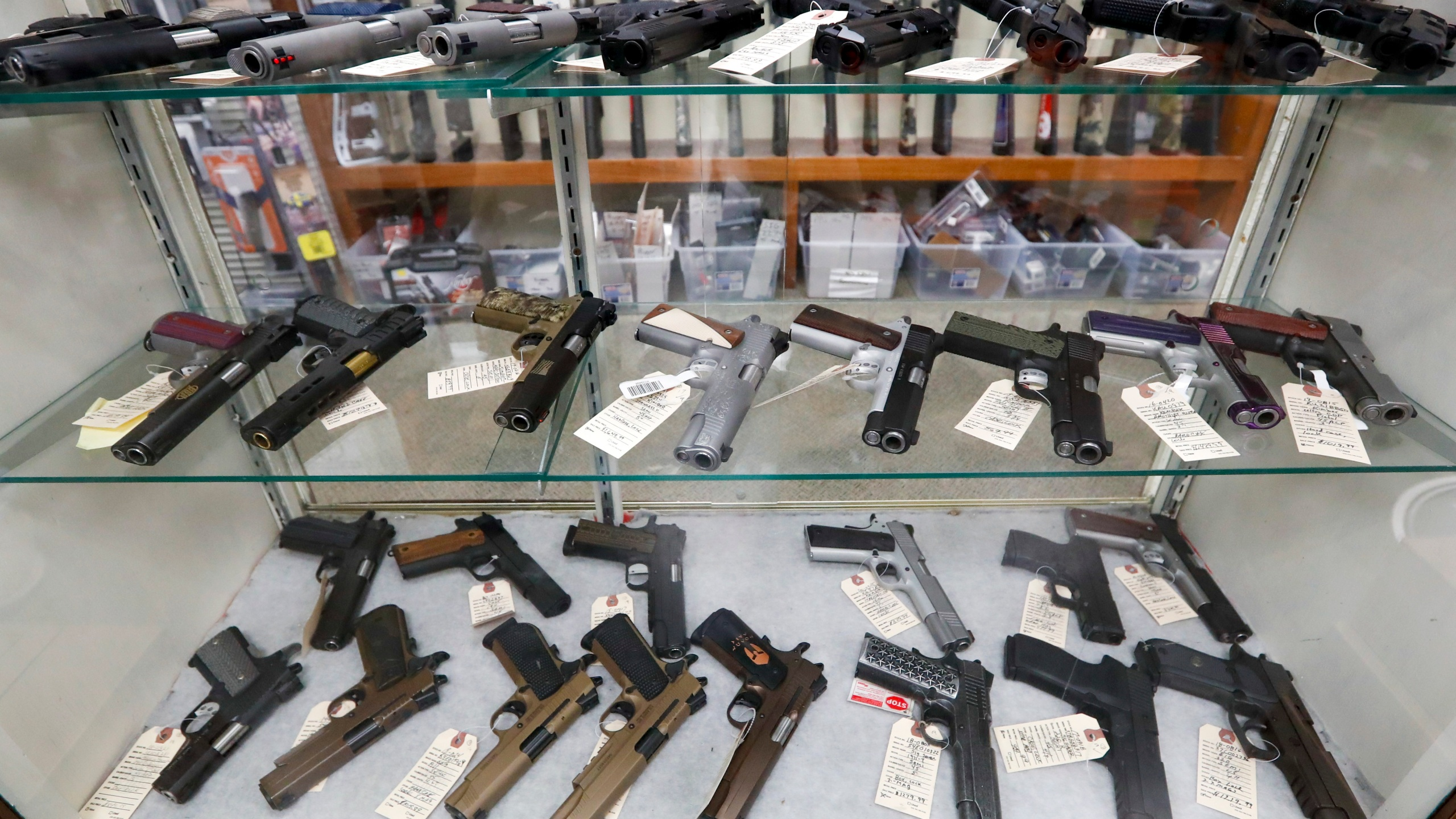 In this March 25, 2020, file photo semi-automatic handguns are displayed at shop in New Castle, Pa. (AP Photo/Keith Srakocic, File)