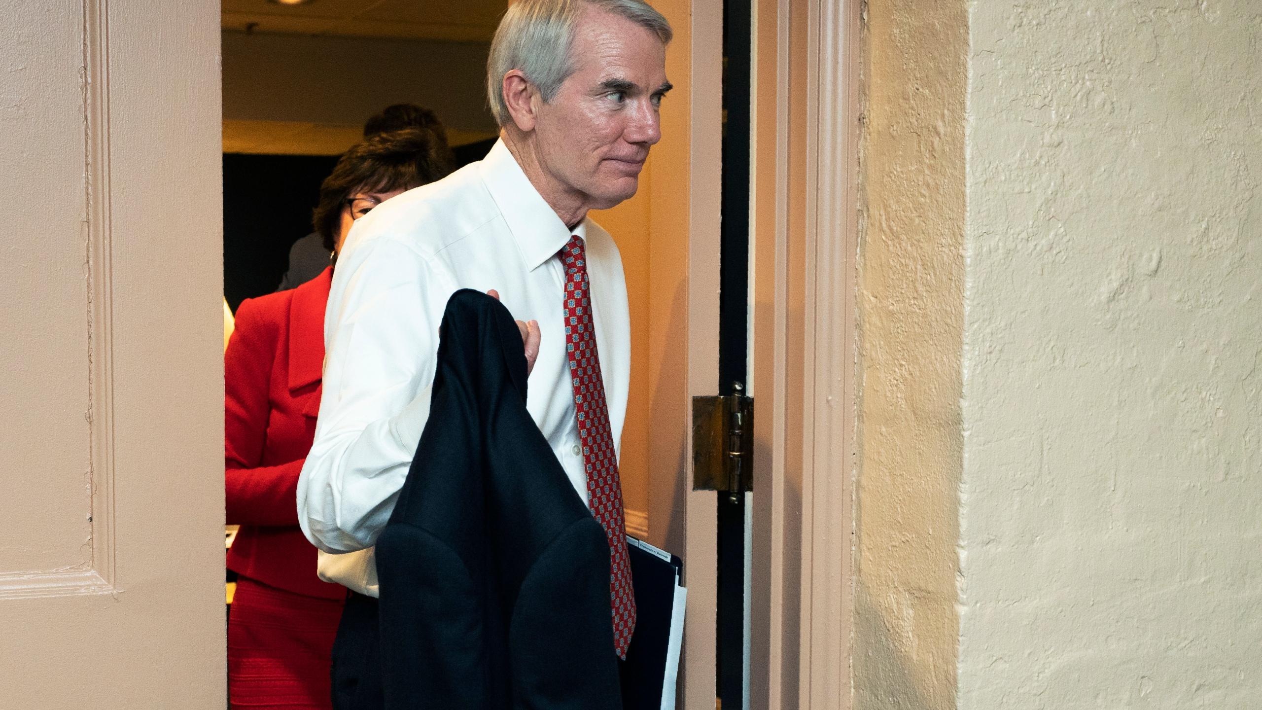 Sen. Rob Portman, R-Ohio, leaves a closed-door bipartisan infrastructure meeting with a group of senators and White House aides on Capitol Hill in Washington on June 22, 2021. (AP Photo/Manuel Balce Ceneta)