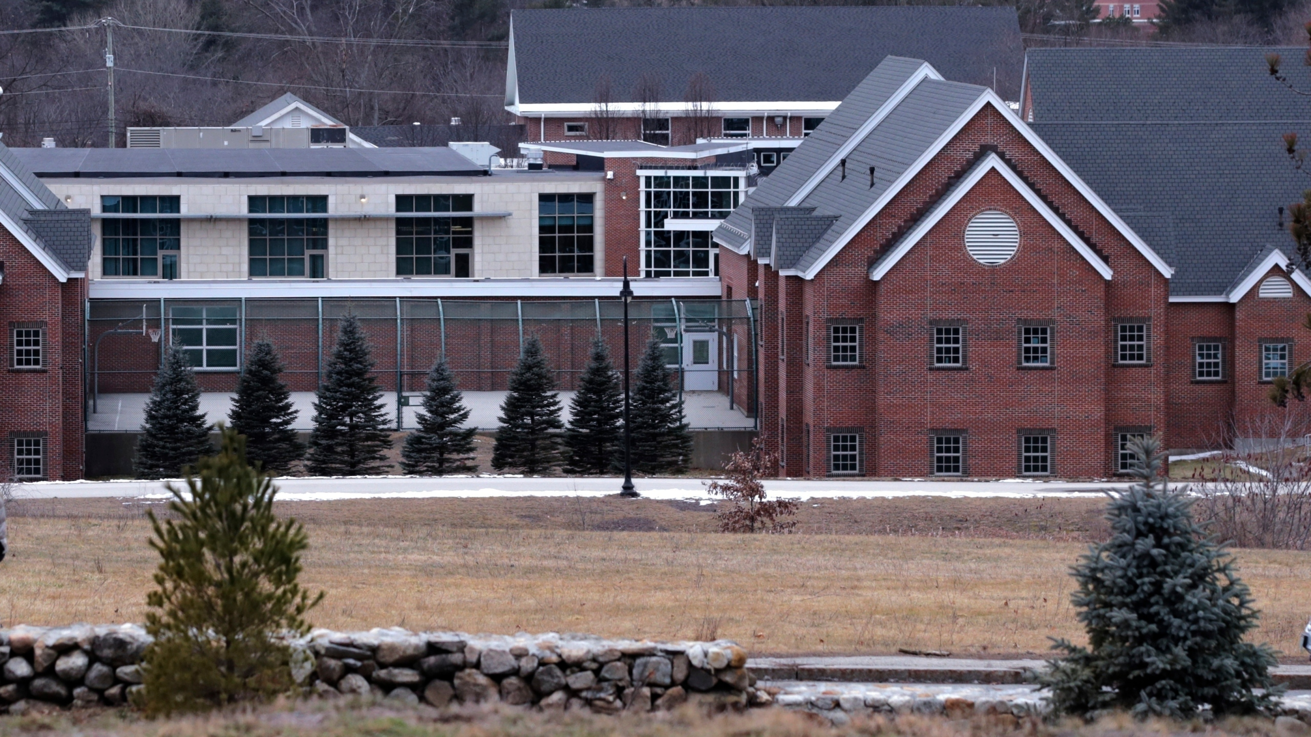 In this Jan. 28, 2020, file photo is the Sununu Youth Services Center in Manchester, N.H. As states from California to Maine consider drastic changes to youth detention centers, New Hampshire is grappling with its own facility that has been rocked by abuse allegations from years past. The state's Legislature will vote Thursday on a proposed state budget that would close the sprawling facility — housing fewer than 20 children on a campus built for 144 — by March 2023 and replace it with a new 18-bed center. (AP Photo/Charles Krupa, File)