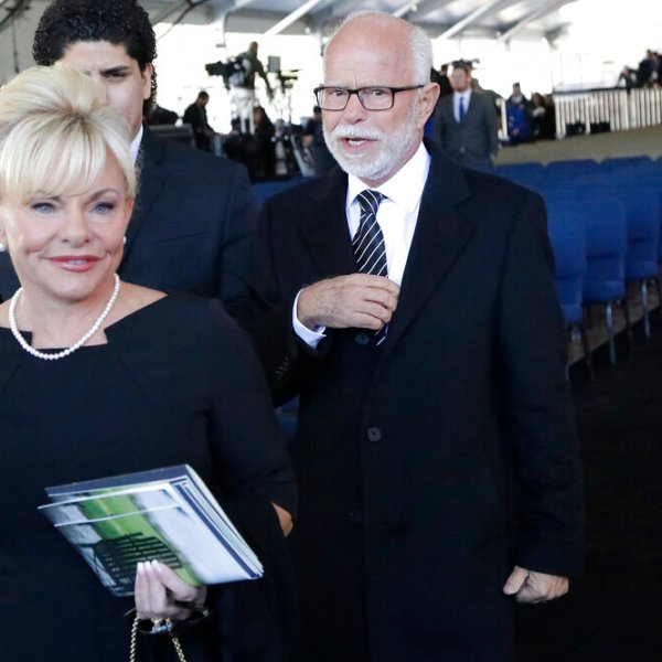In this March 2, 2018 file photo, Televangelist Jim Bakker, right, walks with his wife Lori Beth Graham after a funeral service at the Billy Graham Library for the Rev. Billy Graham, in Charlotte, N.C. (AP Photo/Chuck Burton File)
