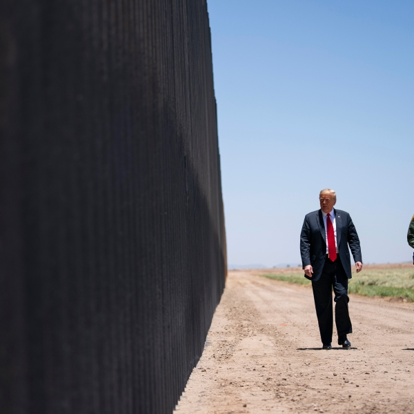 In this June 23, 2020 file photo, U.S. Border Patrol chief Rodney Scott gives President Donald Trump a tour of a section of the border wall in San Luis, Ariz. (Evan Vucci/Associated Press)