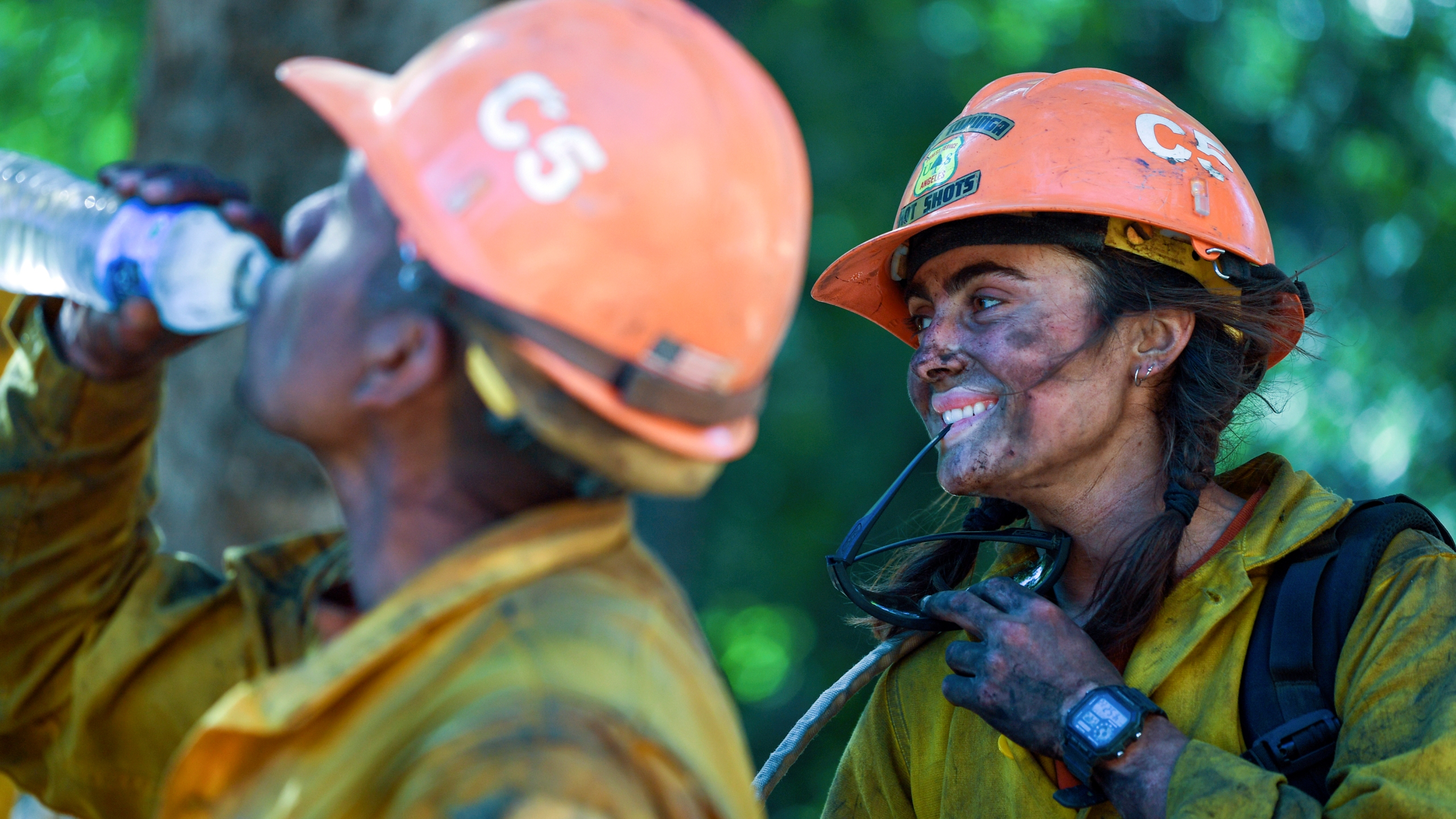 Members of the Little Tujunga Hot Shots take a break after fighting the Willow Fire near the Tassajara Zen Mountain Center in Carmel Valley, Calif., Wednesday, June 23, 2021. (AP Photo/Nic Coury)