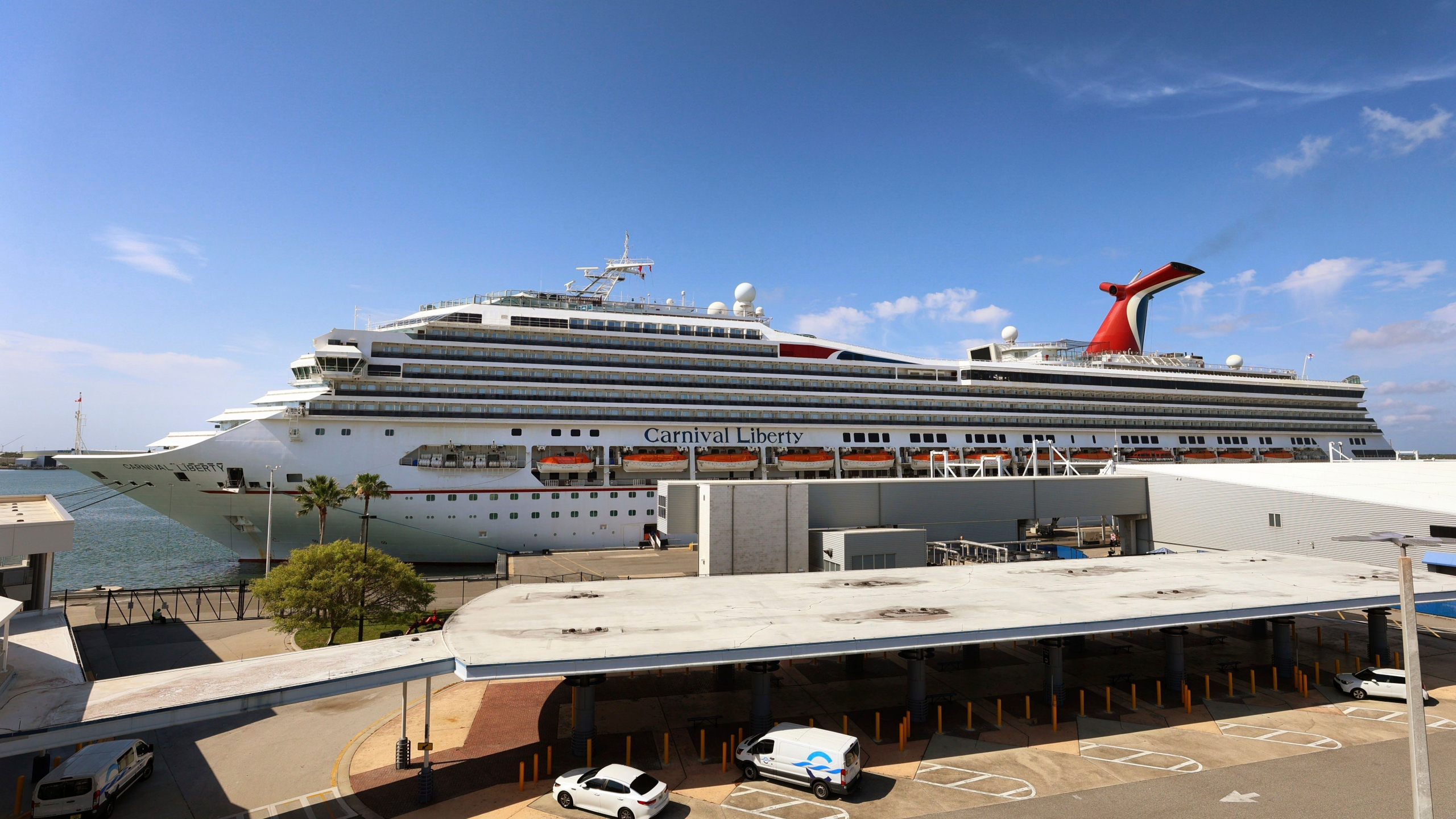 """In this Wednesday, May 12, 2021, file photo, the Carnival Cruise ship """"Liberty"""" is docked at Port Canaveral, Fla. Carnival Corp. continues to lose billions while it waits for cruising to recover from the pandemic. Carnival said Thursday, June 24, that it lost $2.1 billion in its latest quarter. (Joe Burbank/Orlando Sentinel via AP)"""