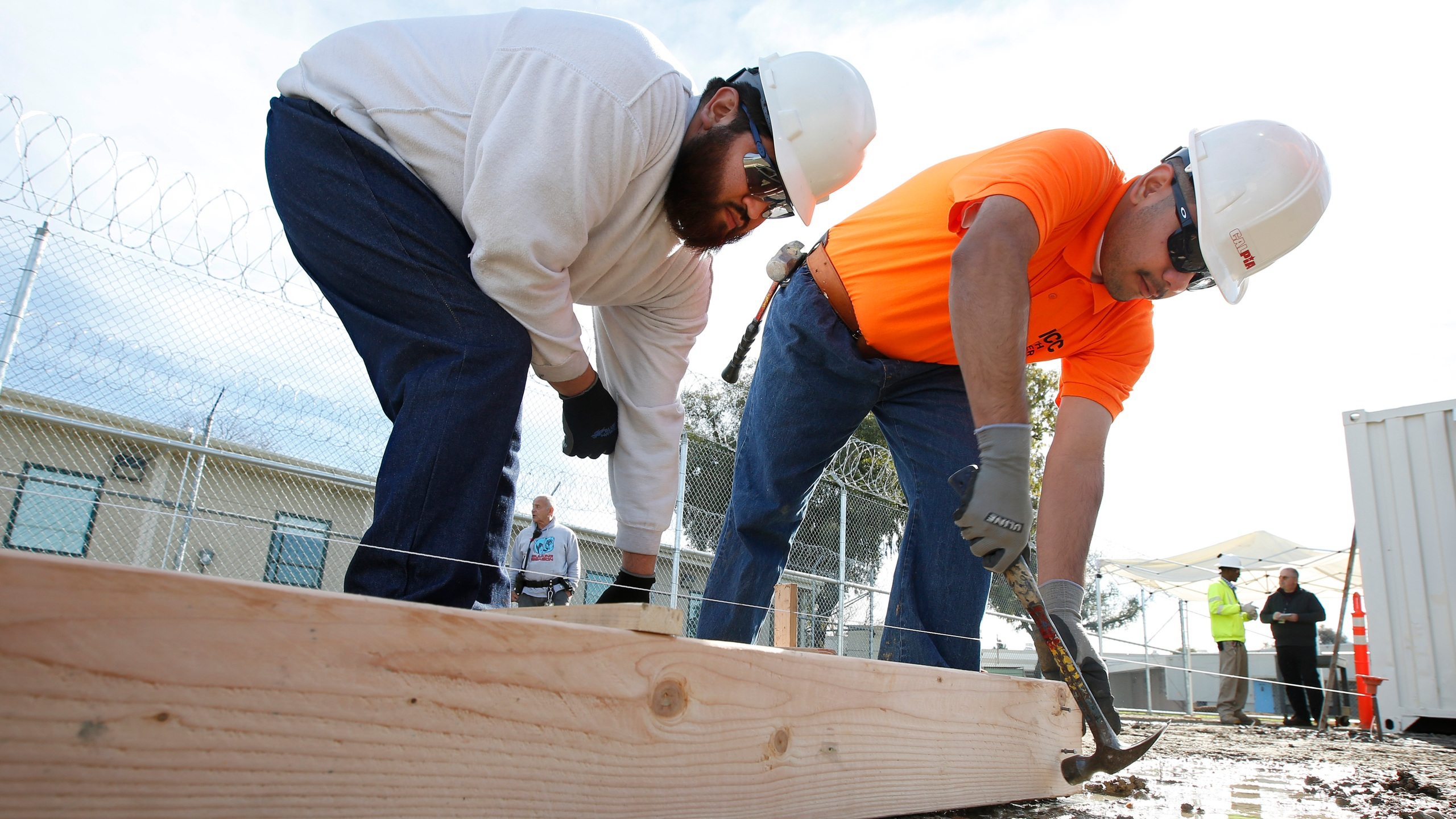 In this Jan. 22, 2019, file photo, youthful offenders Siegmond Navar, left and Gabriel Andalon construct a frame to hold concrete at one of the vocational classes at the O.H. Close Youth Correctional Facility, in Stockton, Calif. California is phasing out its state-run youth prisons and shifting the responsibilities to the counties. The state will not only keep offenders closers to home but transfer oversight form the corrections department to the Health and Human Services Agency. The three remaining state-run lockups, including there O.H Close Youth Correctional Facility, will stop admissions Thursday, July 1 and close for good two years later. (AP Photo/Rich Pedroncelli, File)