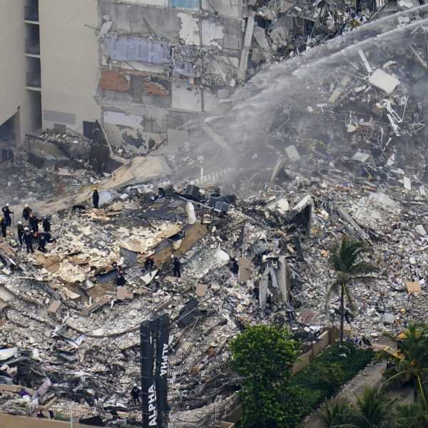 Rescue workers shift through the rubble at the Champlain Towers South Condo in Surfside, Florida, on June 25, 2021, a day after it partially collapsed. (Gerald Herbert / Associated Press)