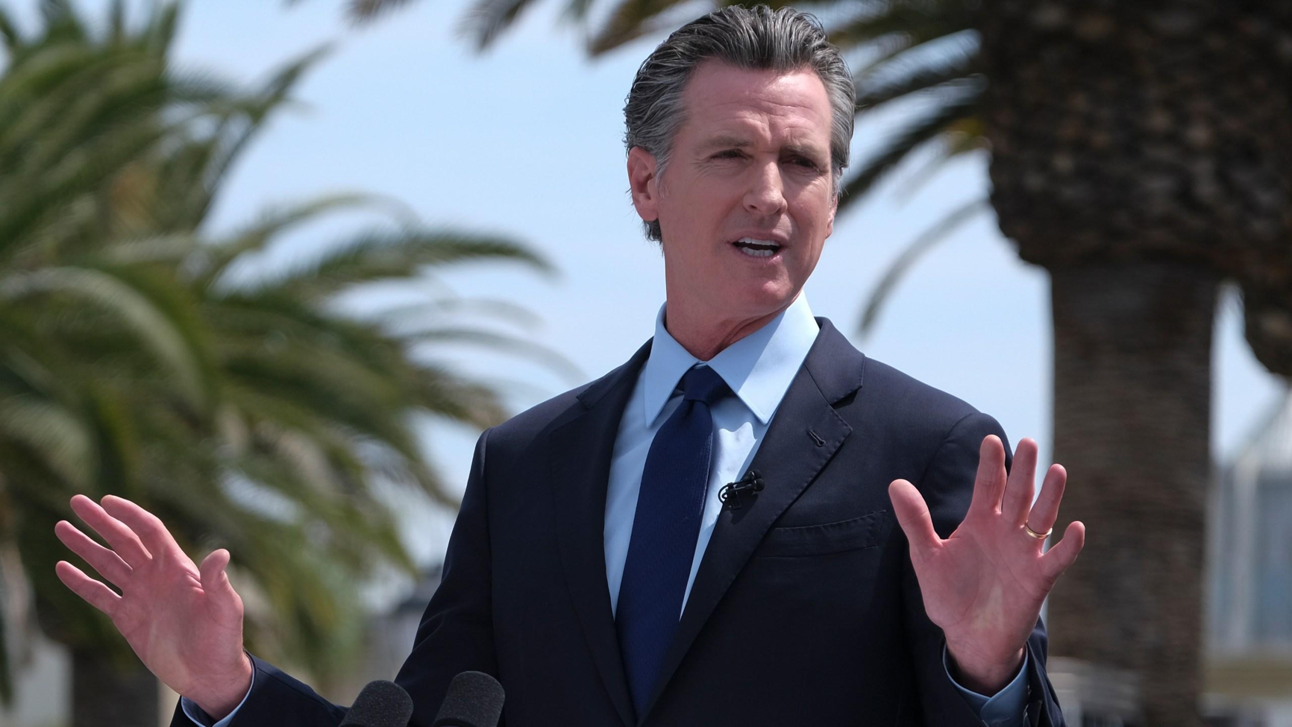 California Gov. Gavin Newsom talks during a news conference at Universal Studios Hollywood on June 25, 2021. (Ringo H.W. Chiu / Associated Press)
