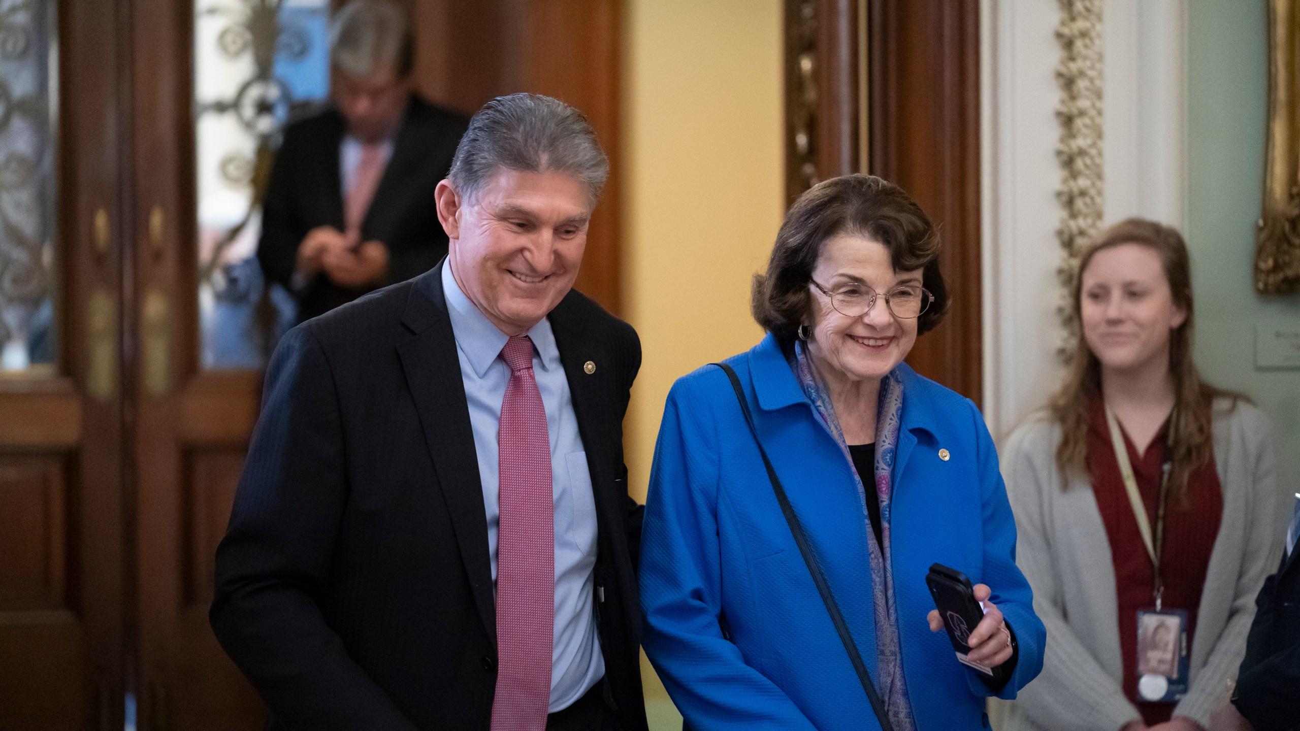 In this Jan. 31, 2020 file photo, Sen. Joe Manchin, D-W.Va., left, and Sen. Dianne Feinstein, D-Calif., walk in the Capitol in Washington. (AP Photo/J. Scott Applewhite)