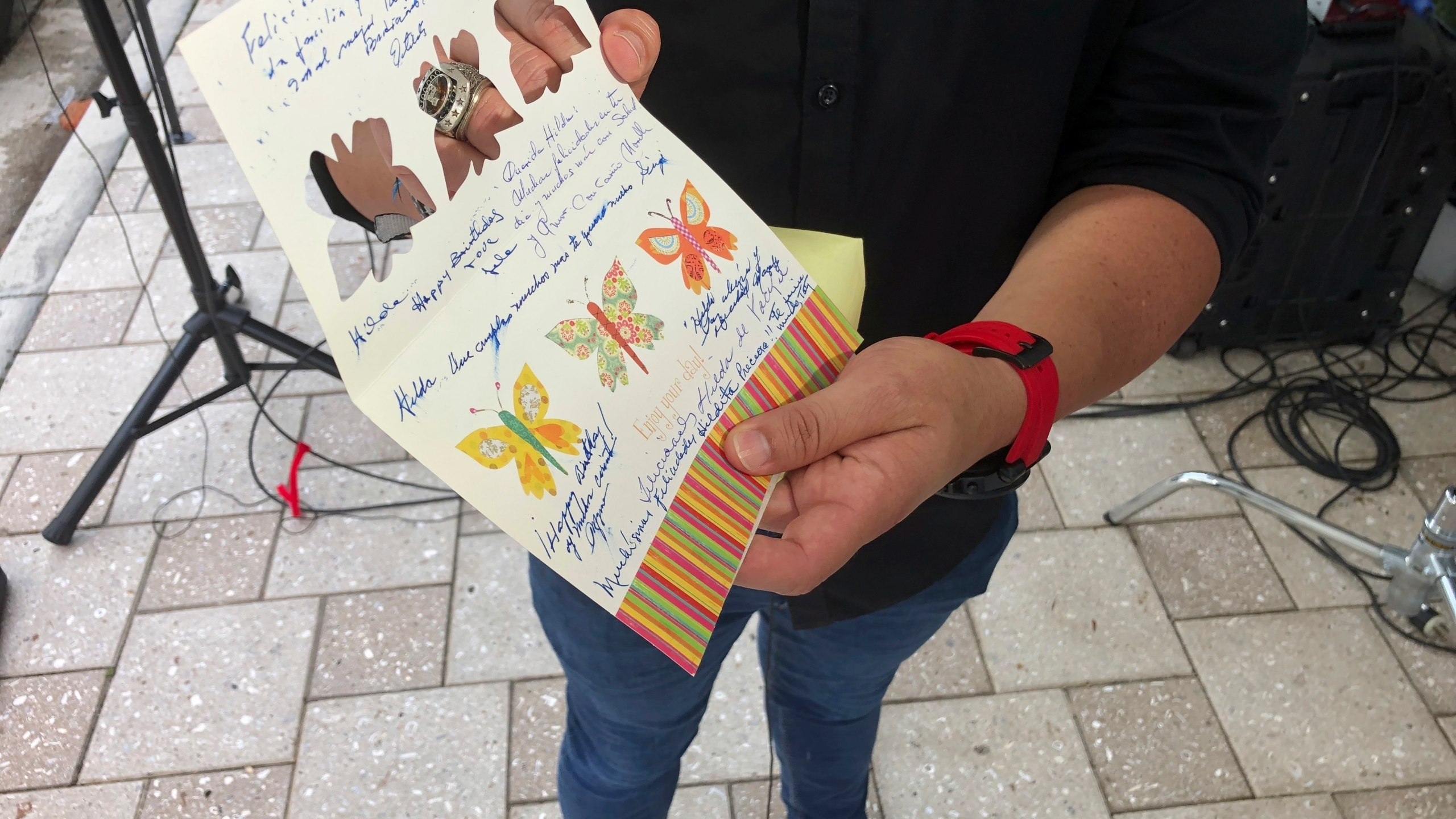Mike Noriega shows a birthday card, Saturday, June 26, 2021, in Surfside, Fla., relatives sent to his grandmother, Hilda Noriega, two weeks ago for her 92nd birthday. Hilda Noriega lives on the sixth floor of the Miami building that collapsed. (AP Photo/Joshua Goodman)
