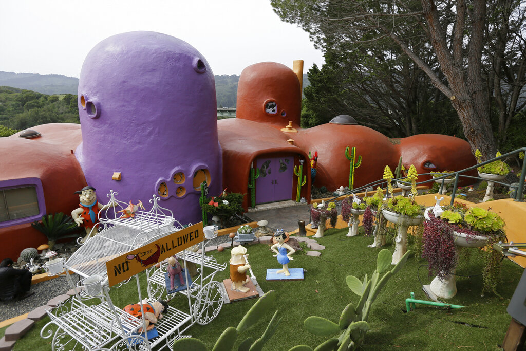 In this Thursday, April 11, 2019, file photo, The Flintstone House is seen before a news conference with the owner and the home's original architect in Hillsborough, California. (AP Photo/Eric Risberg, File)