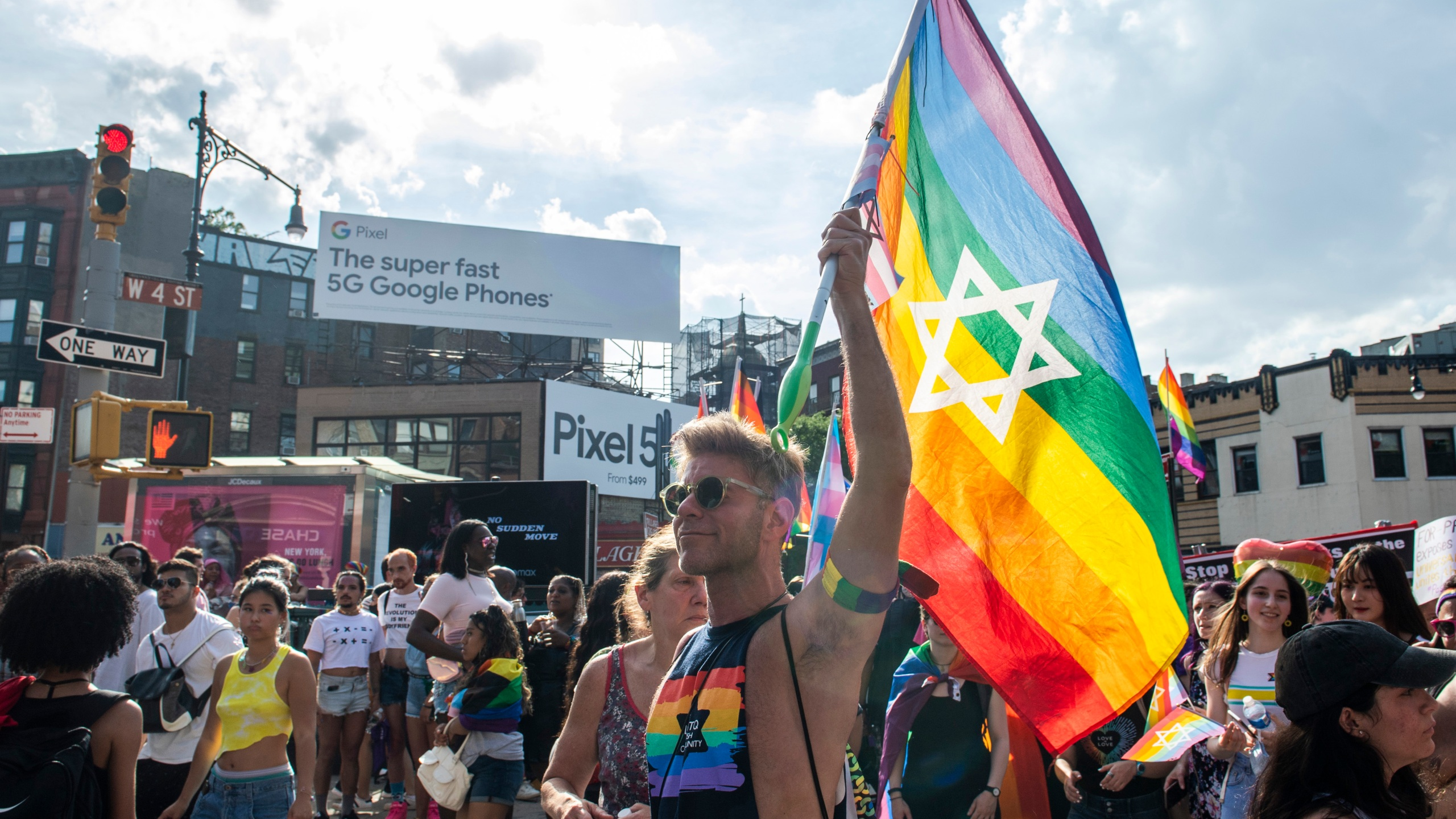 People gather during the Queer Liberation March in the West Village on Sunday, June 27, 2021, in New York. (AP Photo/Brittainy Newman)