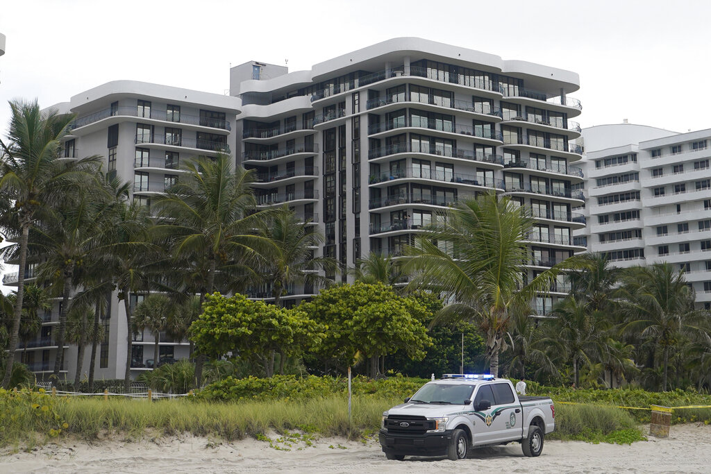 This Thursday, June 24, 2021, file photo, shows a sister building of a condominium that partially collapsed earlier the same day, in Surfside, Fla. (AP Photo/Wilfredo Lee, File)