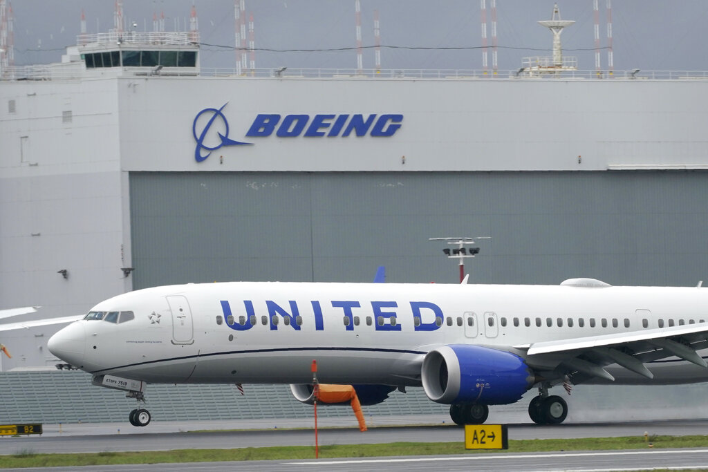 This Nov. 18, 2020, file photo shows a Boeing 737 Max 9 built for United Airlines landing at King County International Airport - Boeing Field after a test flight from Moses Lake, Wash., in Seattle. (AP Photo/Ted S. Warren, File)