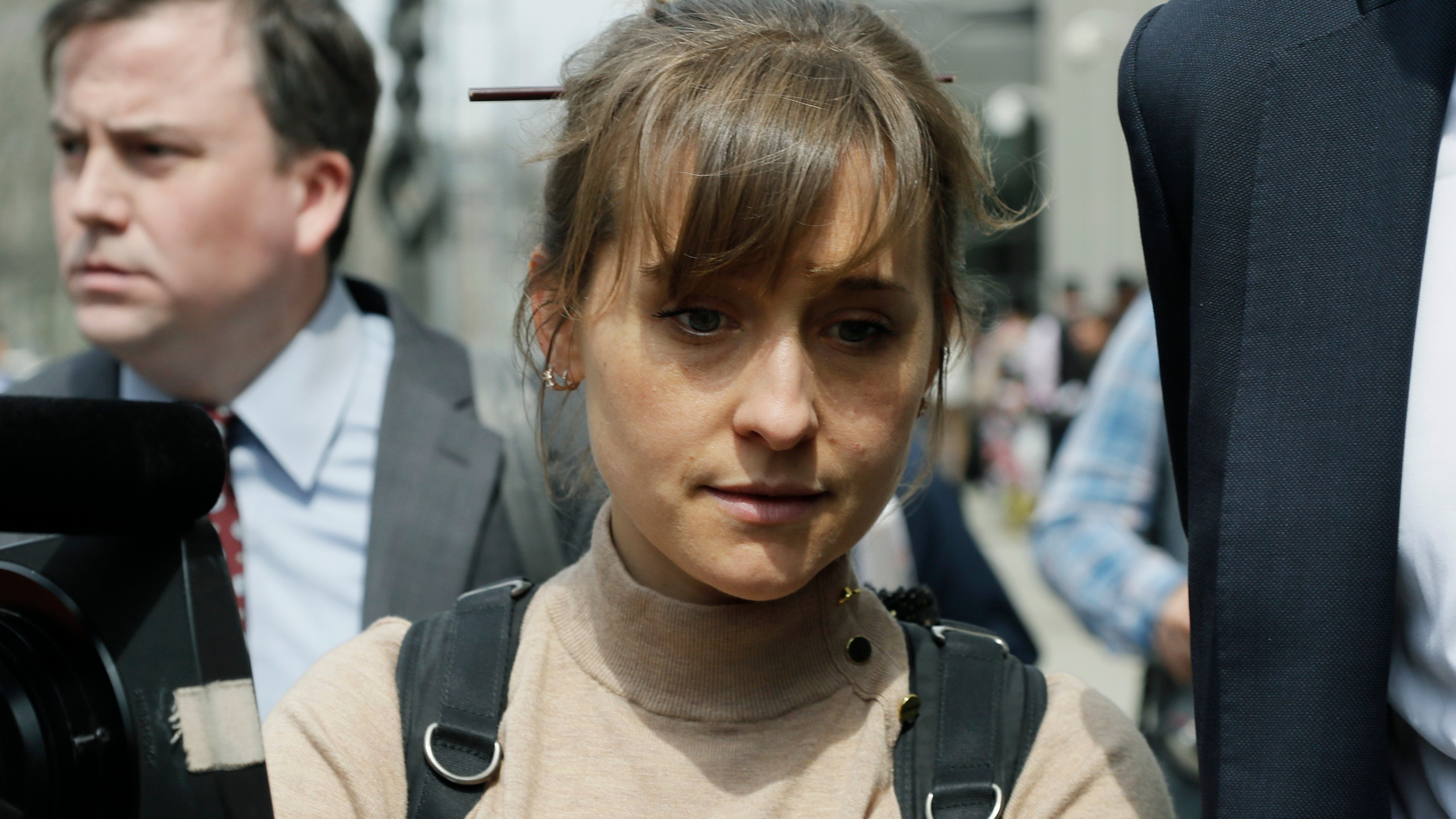 In this Monday, April 8, 2019, file photo, actress Allison Mack leaves Brooklyn federal court in New York. Mack, who played a key role in a scandal-ridden, cult-like upstate New York group, is facing sentencing on June 30, 2021, after pleading guilty to charges she manipulated women into becoming sex slaves for the group's spiritual leader. (AP Photo/Mark Lennihan, File)