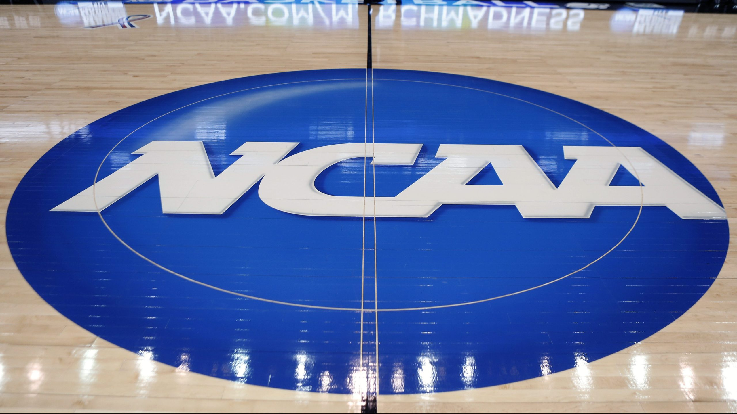 The NCAA logo is displayed at center court as work continues at The Consol Energy Center in Pittsburgh for the NCAA college basketball tournament on March 18, 2015. (Keith Srakocic / Associated Press)