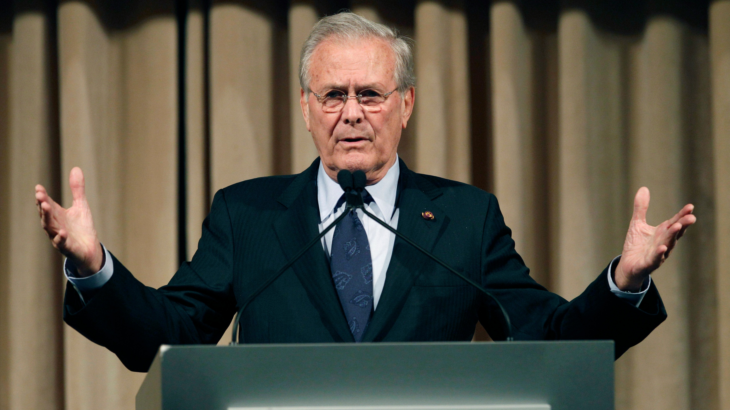 In this Oct. 11, 2011, file photo, former U.S. Secretary of Defense Donald Rumsfeld speaks to politicians and academics during a luncheon on security in rising Asia, in Taipei, Taiwan. The family of Rumsfeld says he has died. He was 88. (AP Photo/Wally Santana, File)