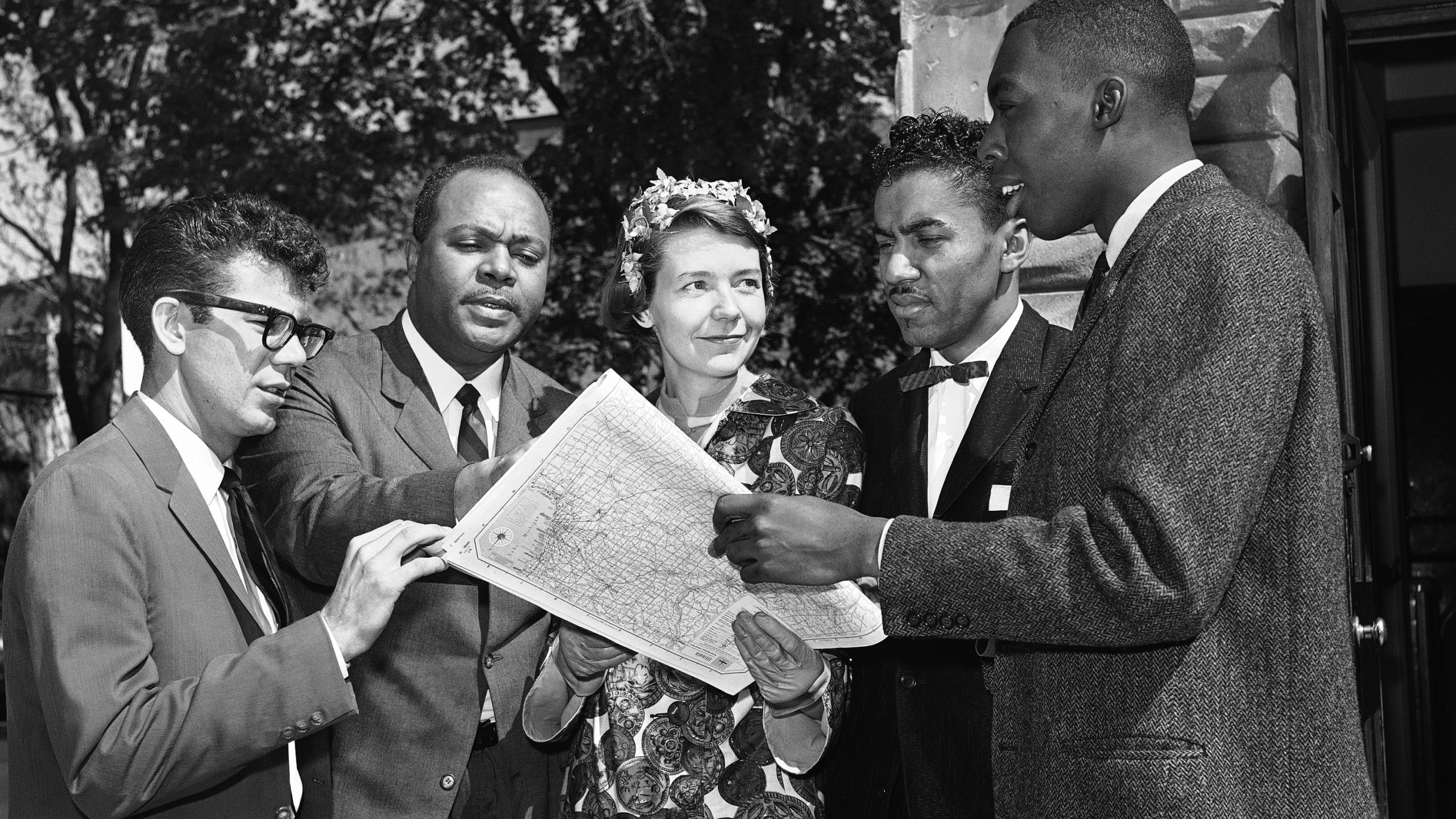 Members of an interracial group pose on May 4, 1961 in Washington with a map of a route they plan to take to test segregation in bus terminal restaurants and rest rooms in the South. (AP Photo/BHR)