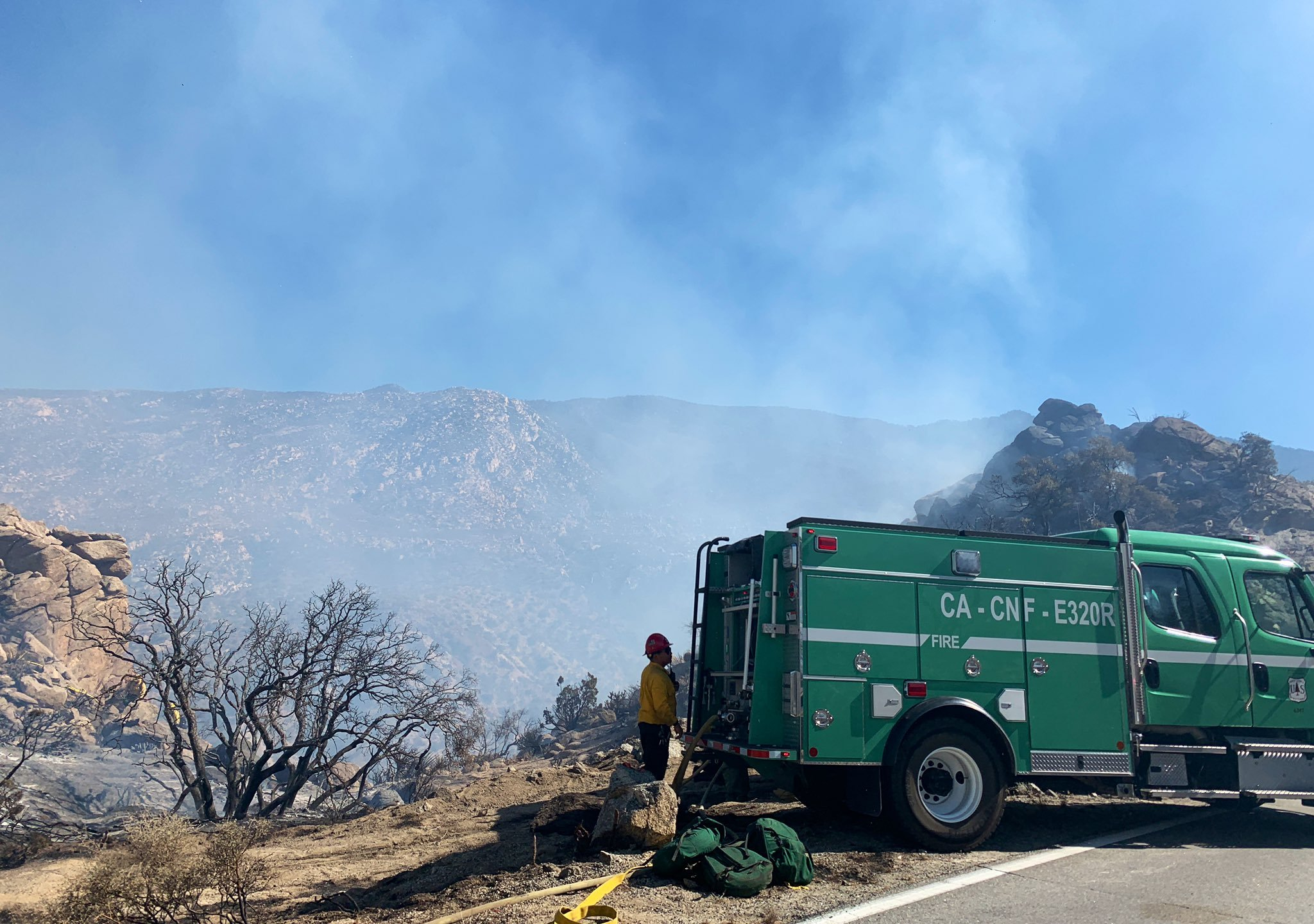 A firefighter standing next to a vehicle near the Flats Fire in Riverside County on June 14, 2021. (San Bernardino National Forest)