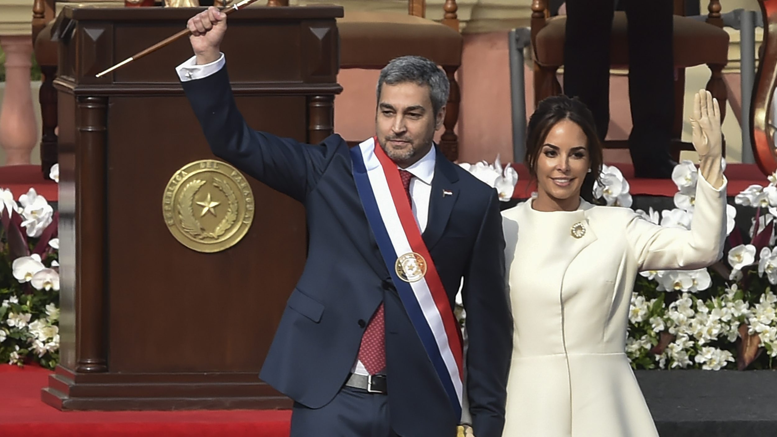 Paraguay's President Mario Abdo Benitez, left, walks next to his wife Silvana Lopez Moreira during his inauguration ceremony in Asuncion on Aug. 15, 2018.(Norberto Duarte / AFP / Getty Images)