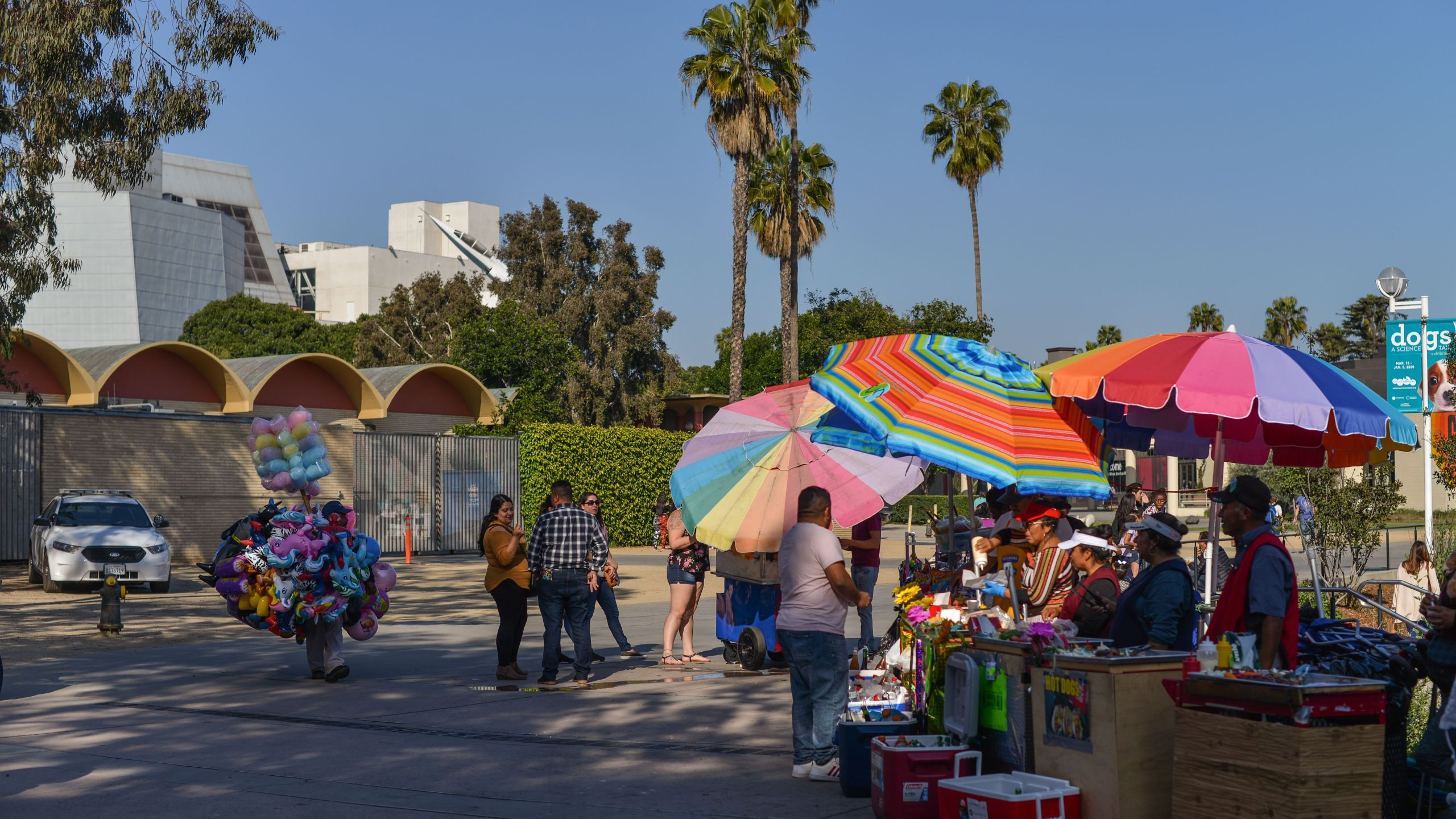 Street vendors work outside the California Science Center at Exposition Park in Los Angeles on March 24, 2019. (Austin Pallier/AFP via Getty Images)