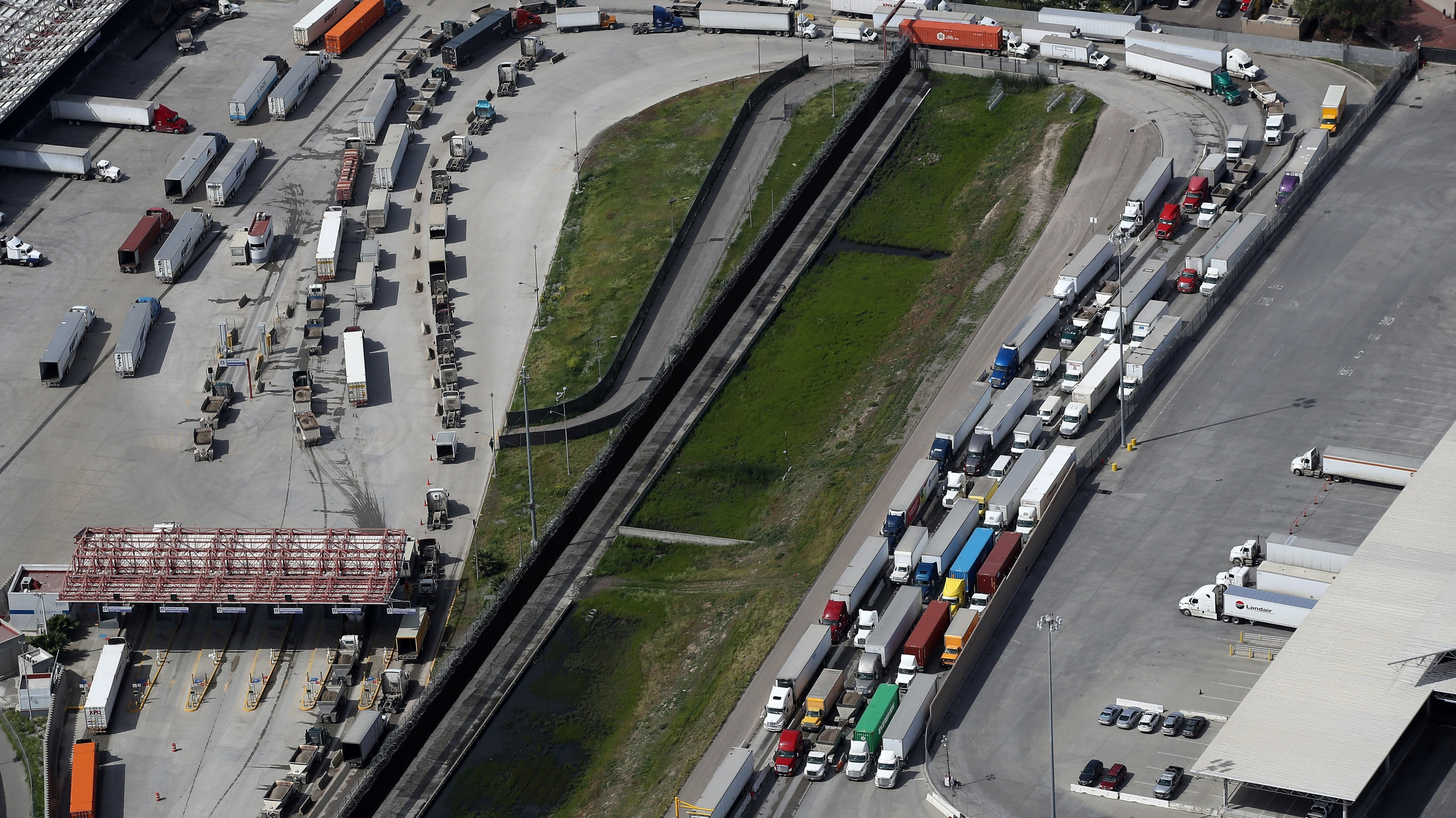 Commercial freight trucks line up to cross into the United States from Mexico through the U.S. Customs and Border Protection - Otay Mesa Port of Entry on March 20, 2020 in San Diego. (Sean M. Haffey/Getty Images)
