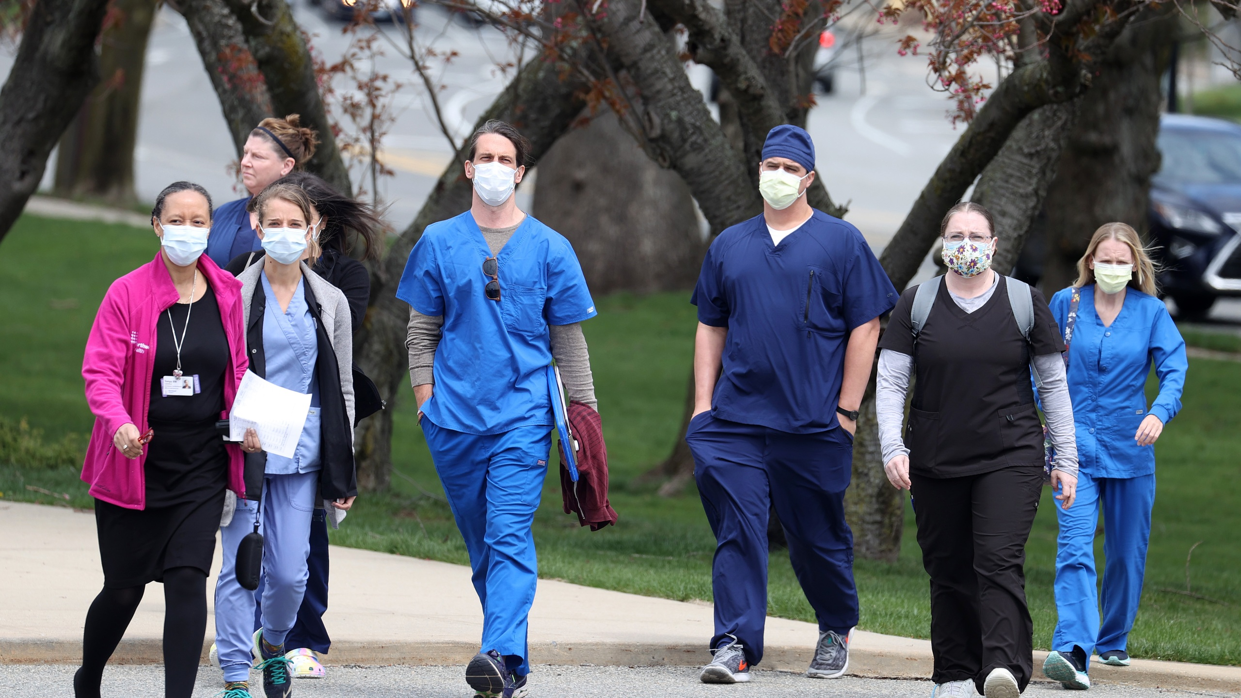 Nurses arriving from around the country to help treat coronavirus (COVID-19) patients arrive and will be met by staff Nurses and administrators welcoming them with a clap in at the Long Island Nursing Institute on April 14, 2020 in New Hyde Park, New York. (Al Bello/Getty Images)