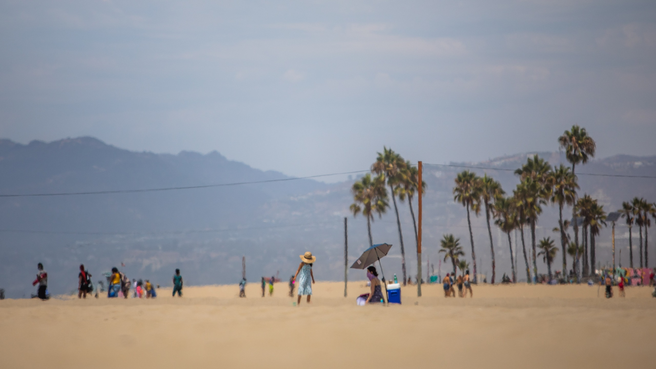 People enjoy the beach amid the severe heat wave in Venice, California on August 15, 2020. (Apu Gomes/AFP via Getty Images)People enjoy the beach amid the severe heat wave in Venice, California on August 15, 2020. (Apu Gomes/AFP via Getty Images)