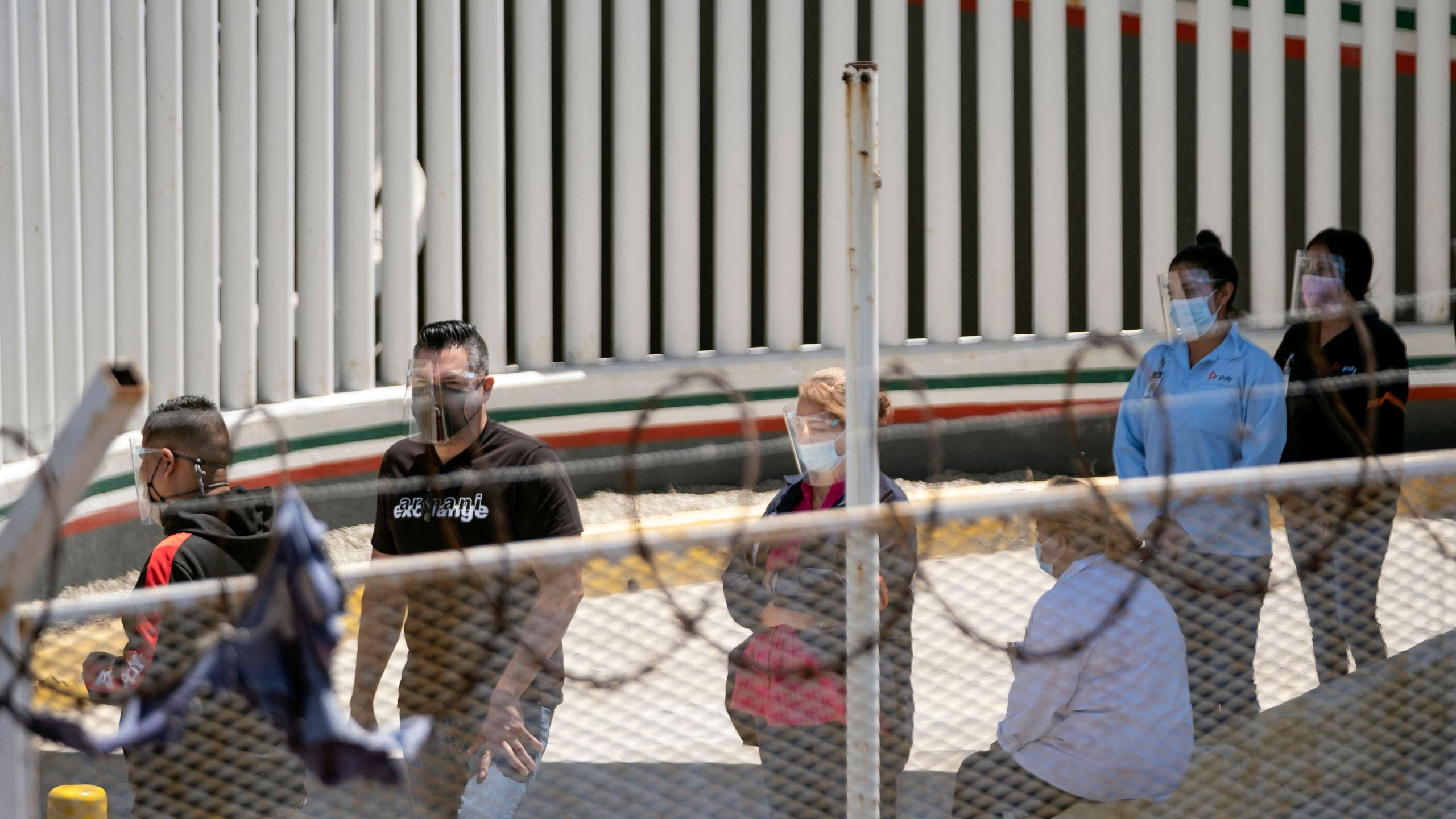 Maquila workers line up to cross the border and get vaccinated against COVID-19 on the U.S. side as seen from El Chaparral crossing port of Tijuana, Baja California state, Mexico on May 25, 2021. (GUILLERMO ARIAS/AFP via Getty Images)