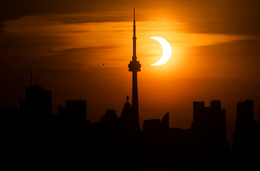 The sun rises behind the skyline during an annular eclipse on June 10, 2021 in Toronto, Canada. (Mark Blinch/Getty Images)