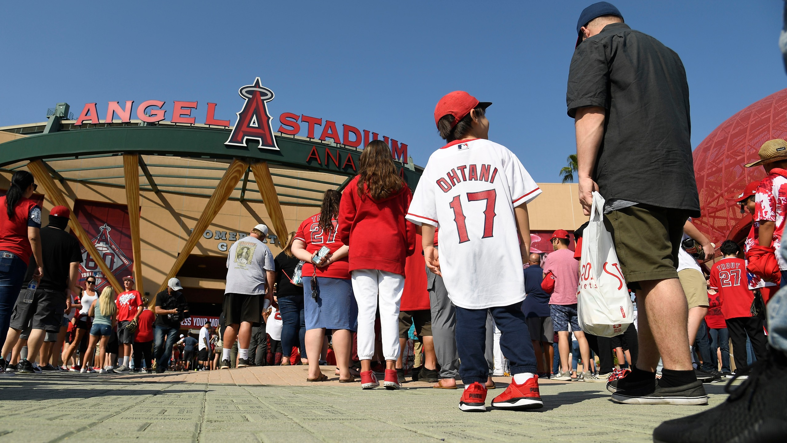 Fans wait to enter Angel Stadium in Anaheim for a baseball game between the Detroit Tigers and Los Angeles Angels on June 17, 2021, the venue's first full capacity game since the start of the coronavirus pandemic. (Kevork Djansezian / Getty Images)